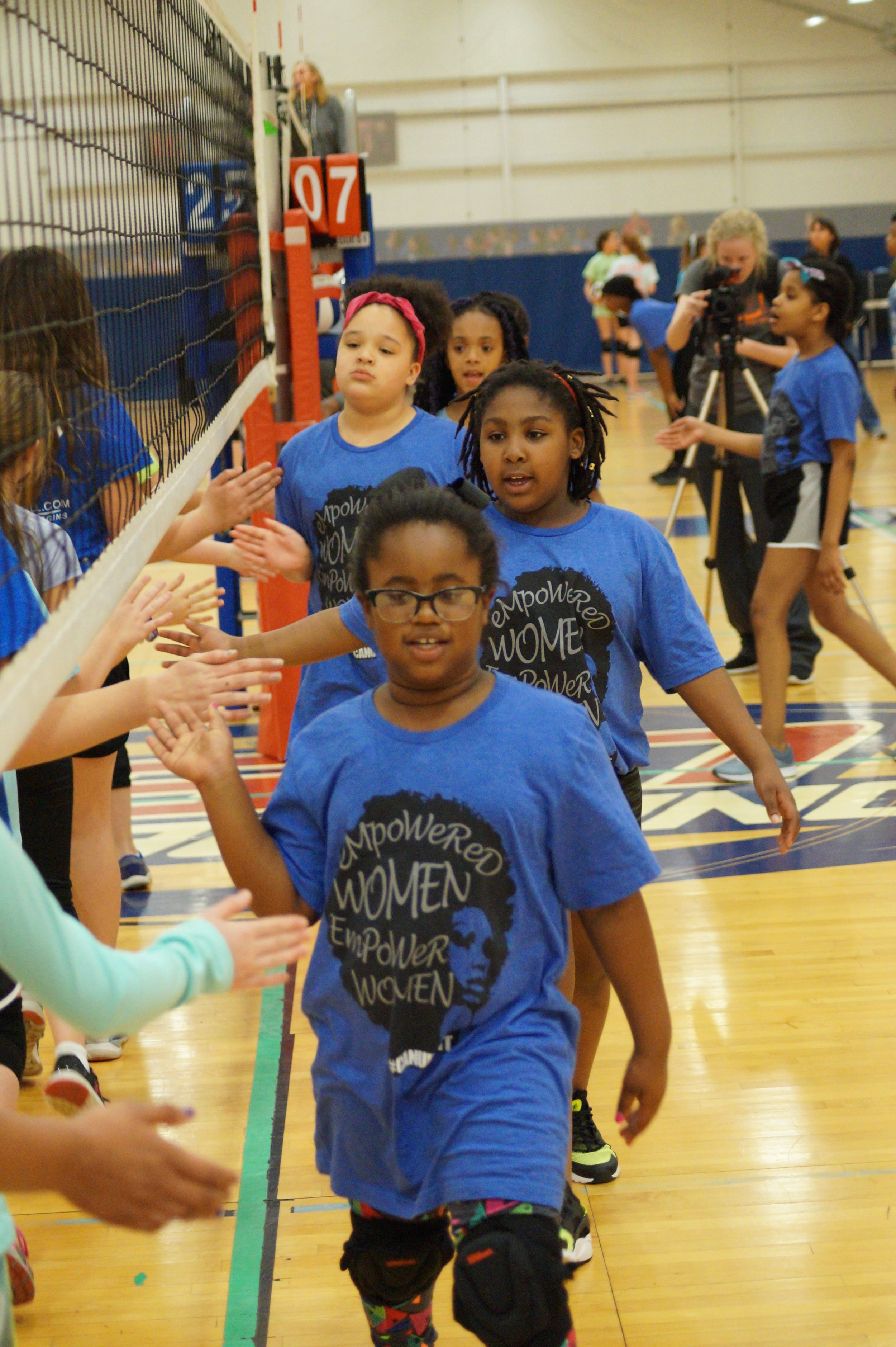 2016 DIG it! Volleyball participants shaking hands after a Friday night League Match.