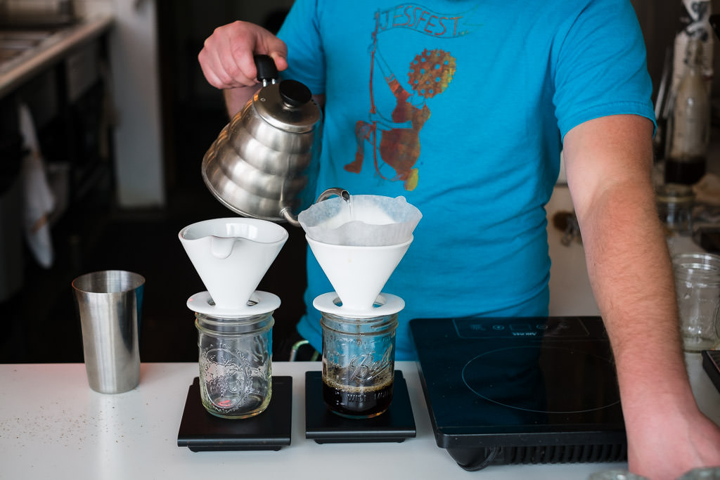 Barista make coffee in a pour over at a coffee shop