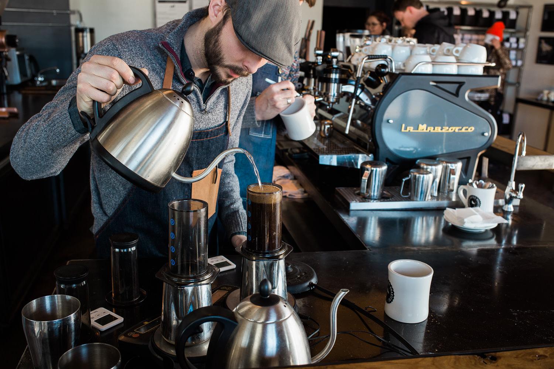 Corvus Coffee barista brewing coffee with an Aeropress