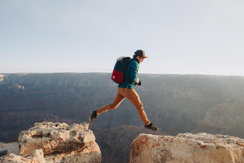 Guy jumping across gap at the Grand Canyon