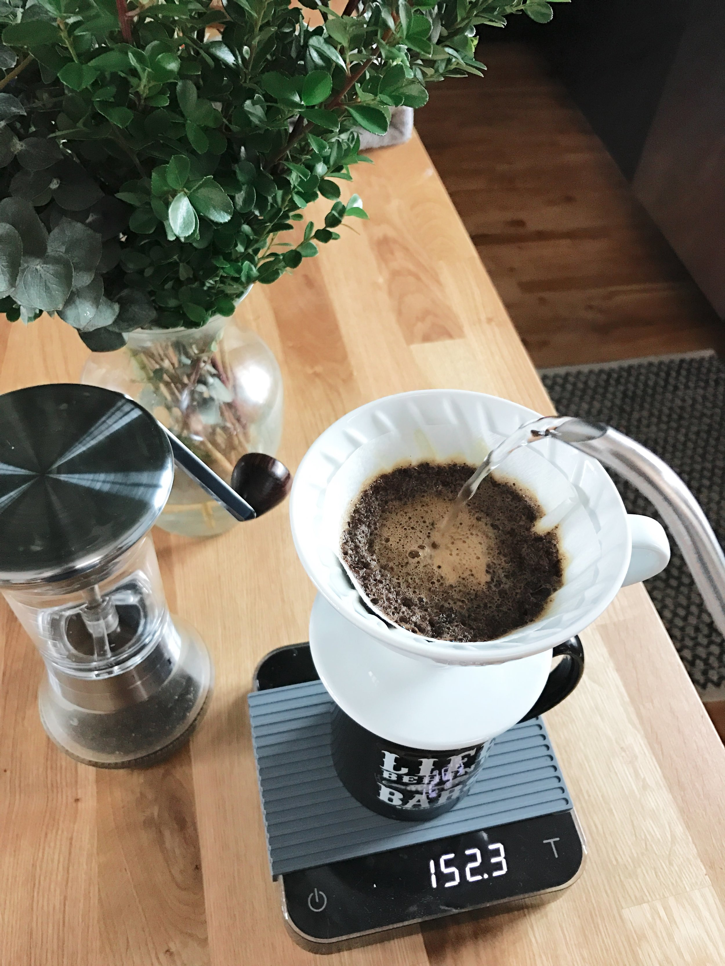 Pour over coffee using acaia pearl scale and handground grinder