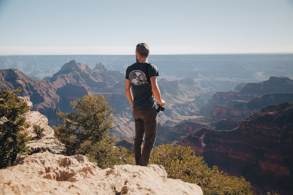 Photographer standing on the edge of the Grand Canyon