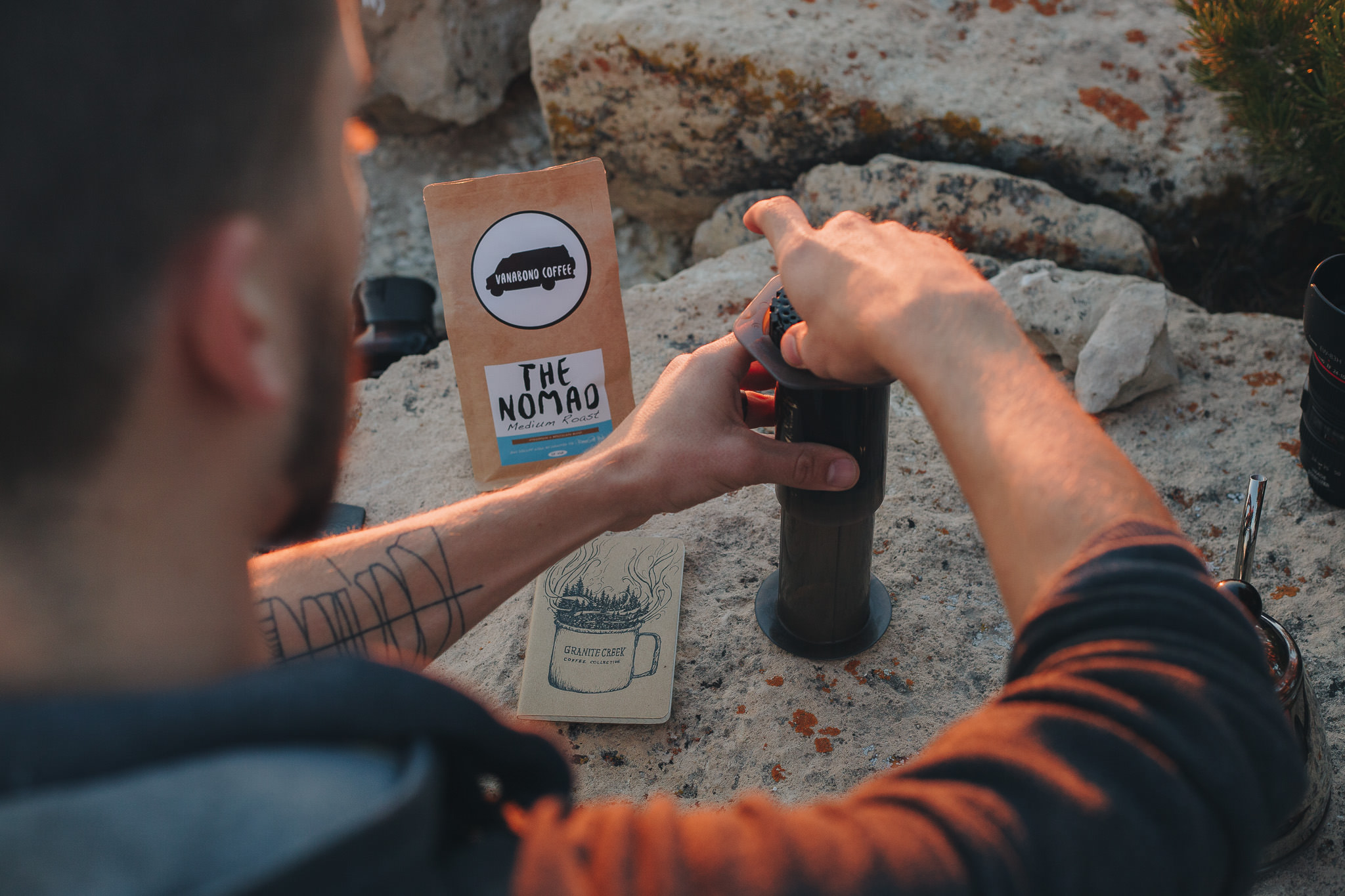 Steeping coffee in an Aeropress while adventuring outdoors