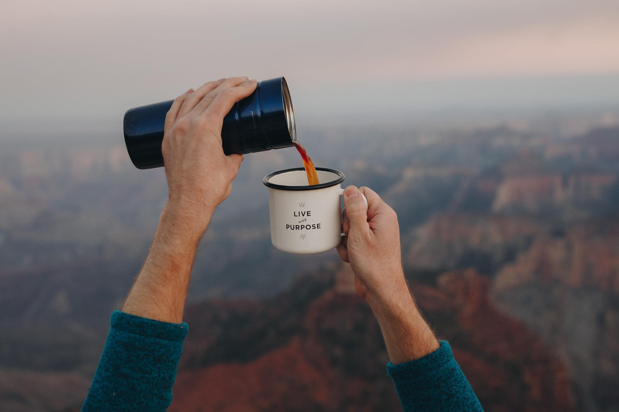 Pouring Aeropress coffee into Created Co mug