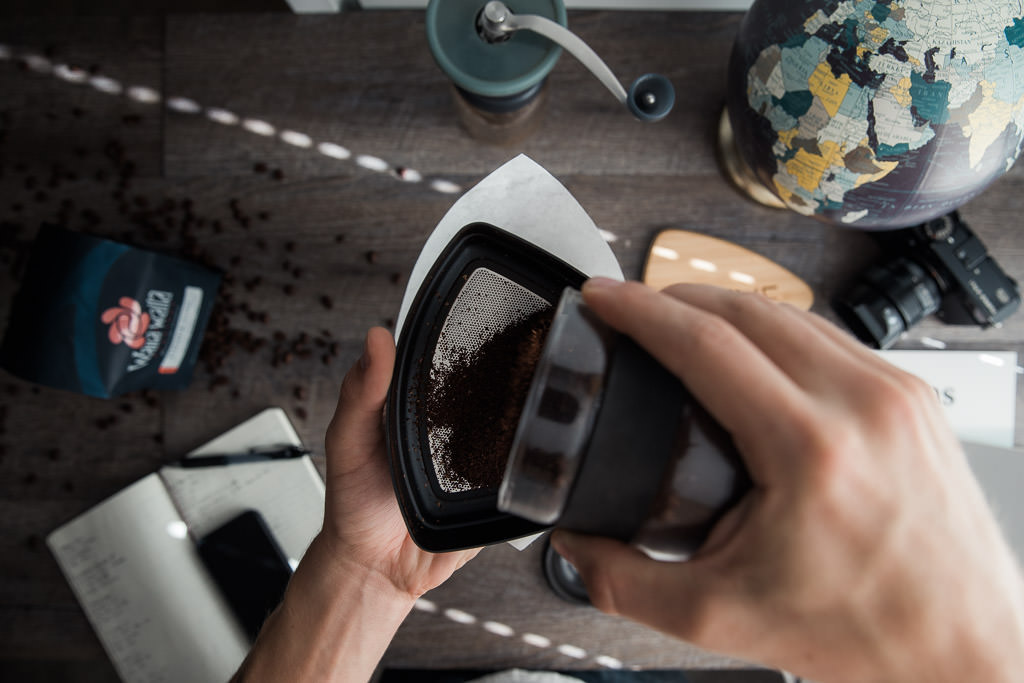 Adding coffee to Kruve sifter