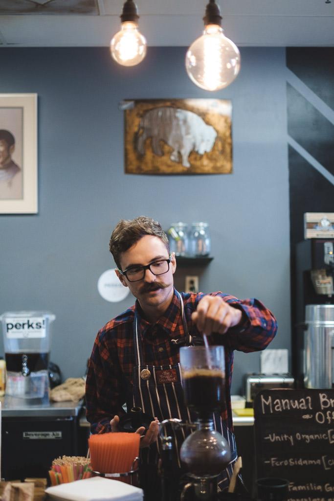 Barista Perks Espresso Utah brews coffee with a siphon