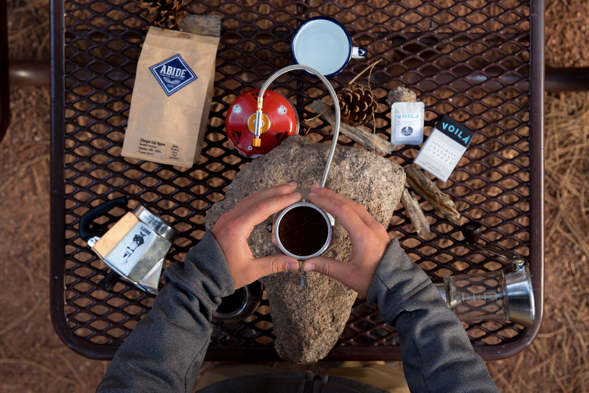 Brewing coffee with a moka pot while camping