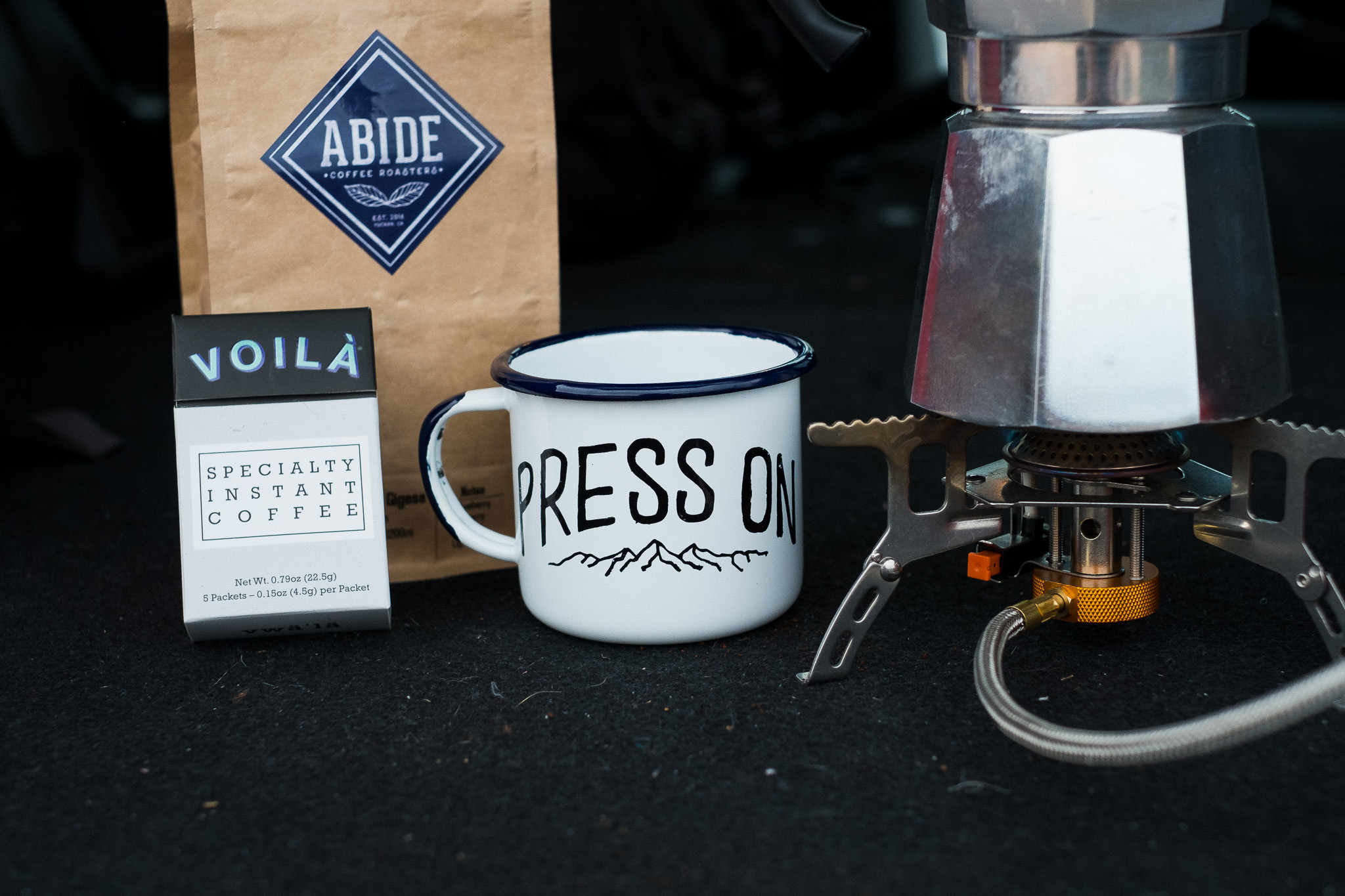 Win a Moka Pot, freshly roasted coffee, 2 boxes of specialty instant coffee and a hand painted camp mug.