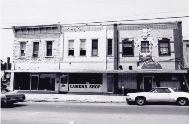 This is what the corner of Dickson Street and West Avenue looked like a few years before the buildings were renovated.