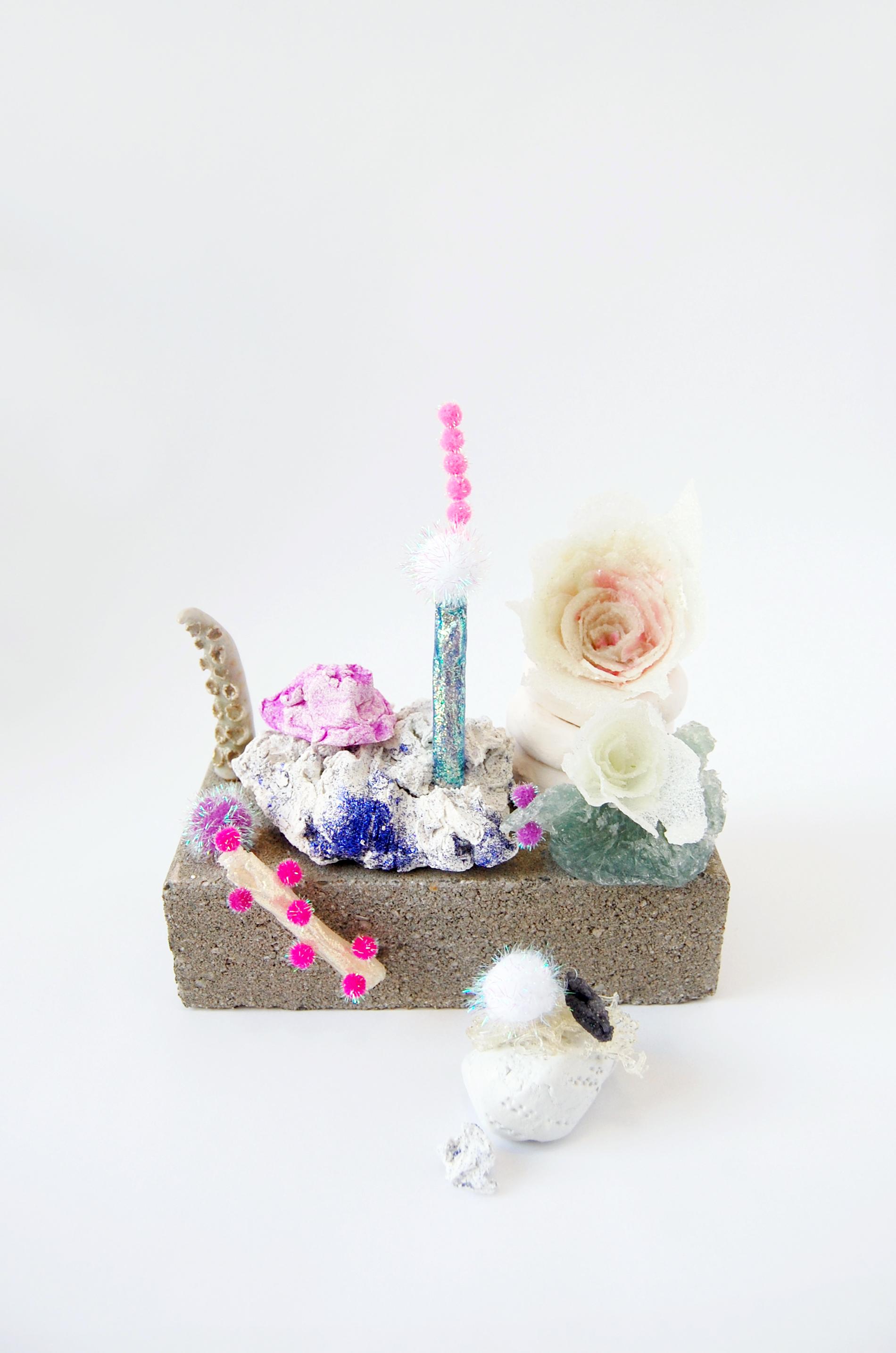 A Garden  , 2016 Brick, glazed ceramic, stoneware, sheetrock joint compound, sheetrock joint compound gel,medium gel, acrylic, glitter glue, pompom, epoxy clay and glitter 9x7.5x7 inches