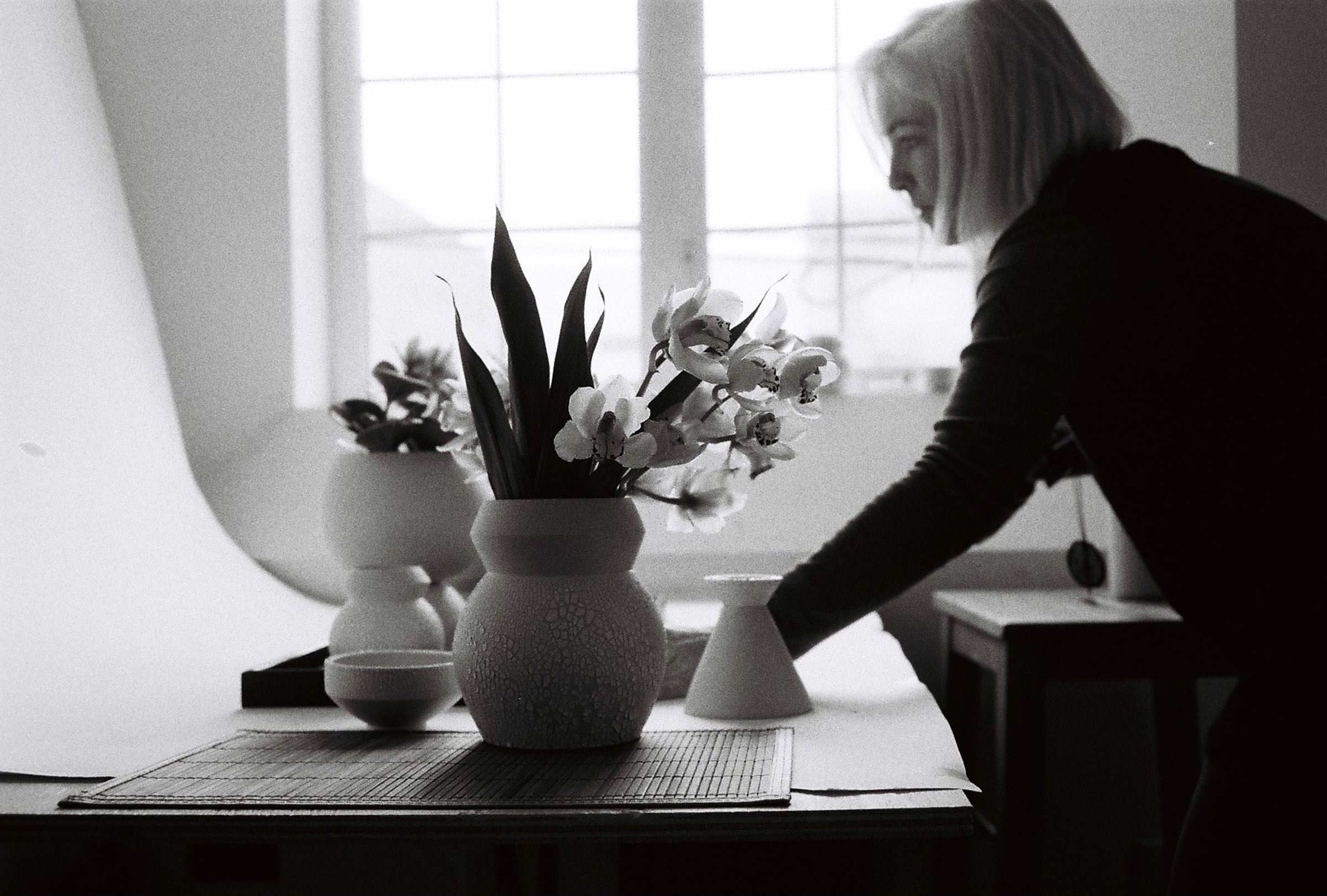Monique Skelton taking photographs of her pots in a Japanese style shoot.