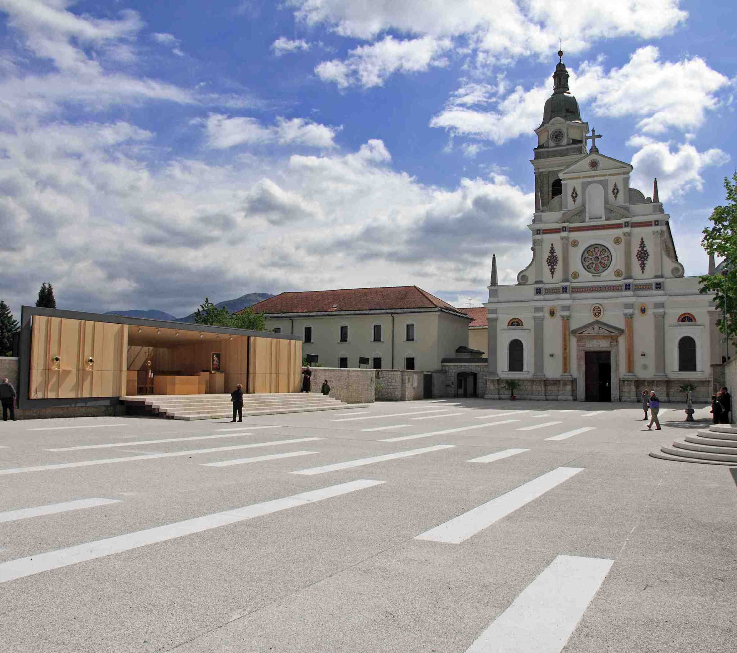 Maruša Zorec - Modern chapel in the historic piazza of Brezje Slovenia, which allows for large numbers of 'pilgrims' to take mass in the open square, outside the old historic church. Large hinged doors allow the chapel to be opened and closed.