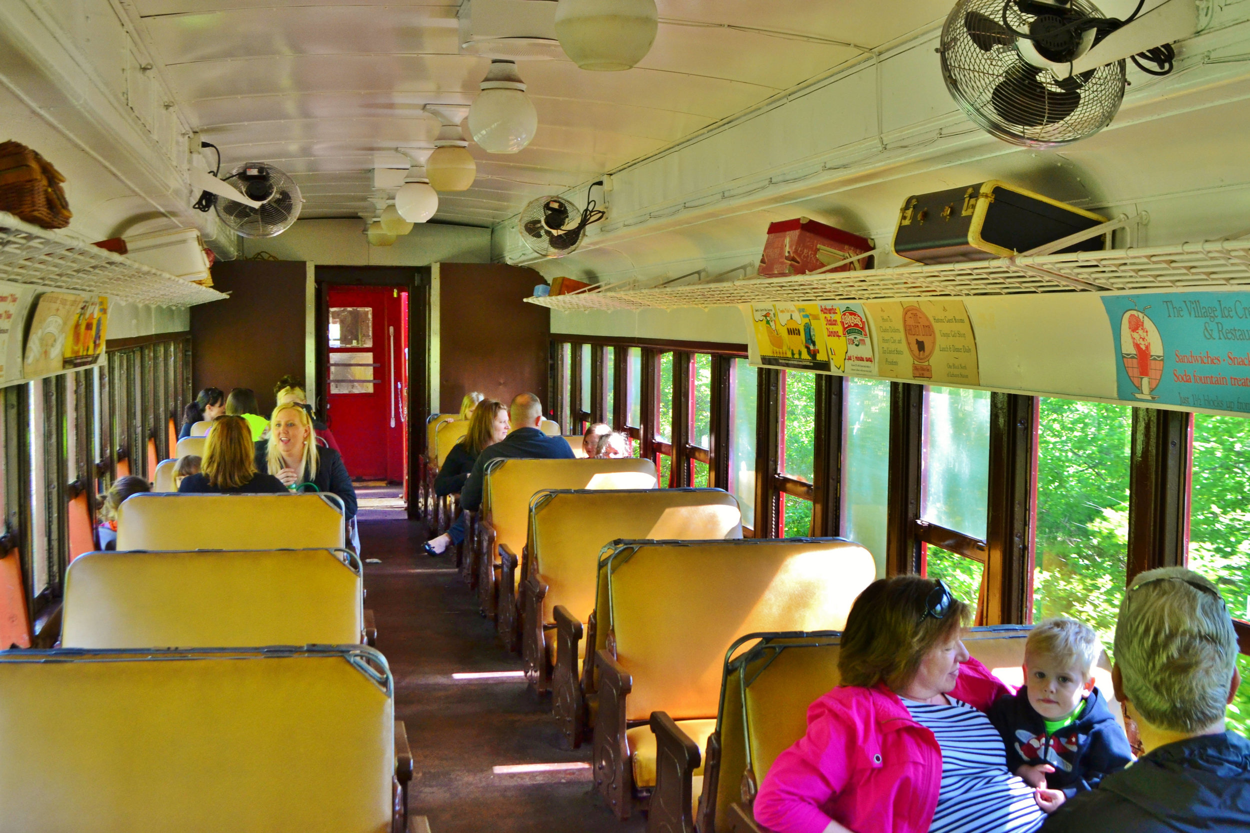 Lackawanna coach interior. This car was built in 1930 and features open windows.