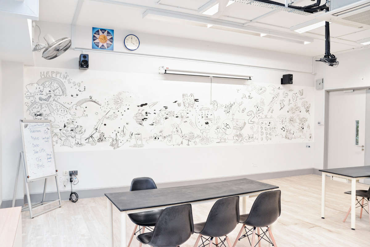Assumption English School - Dry Erase IdeaPaint walls breaks the boundaries of traditional whiteboard panels.