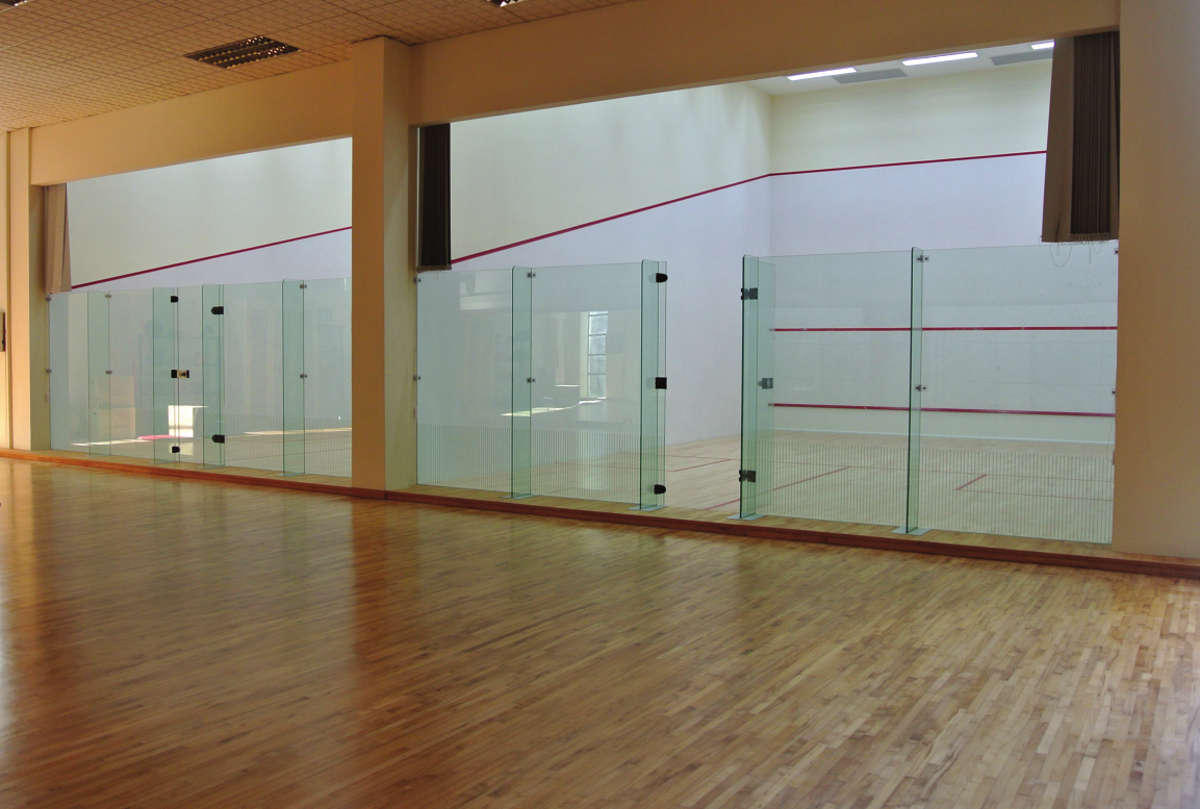 ACJC Squash Court - With Armourcoat specialist heavy duty walls, Junckers sports grade pre-finished timber flooring, and specialist glass walls and doors, to comply with necessary standards.