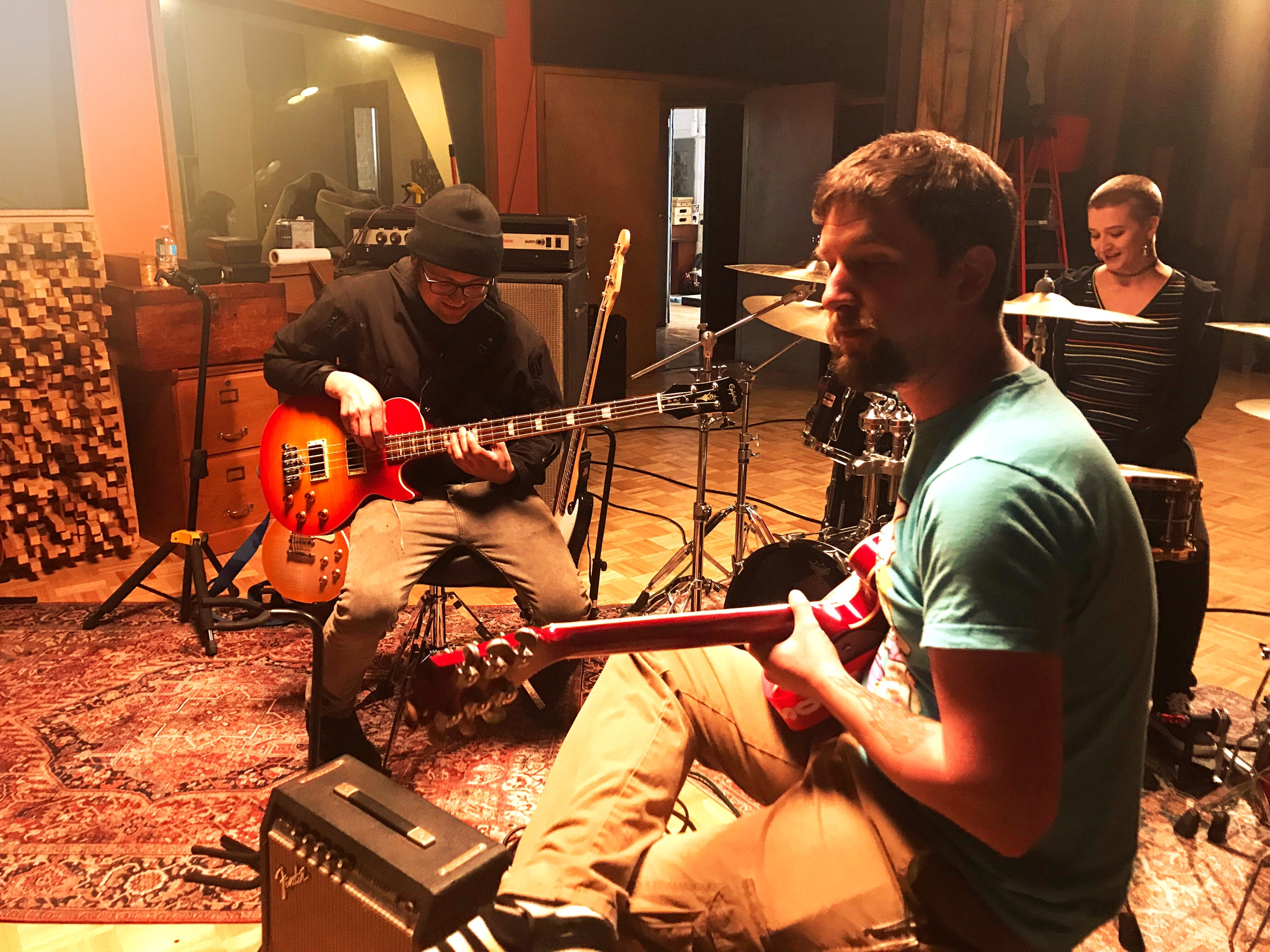 Local Cleveland creatives tuning & testing musical instruments used for filming The Garage featured in downtown Cleveland's Rock & Roll Hall of Fame