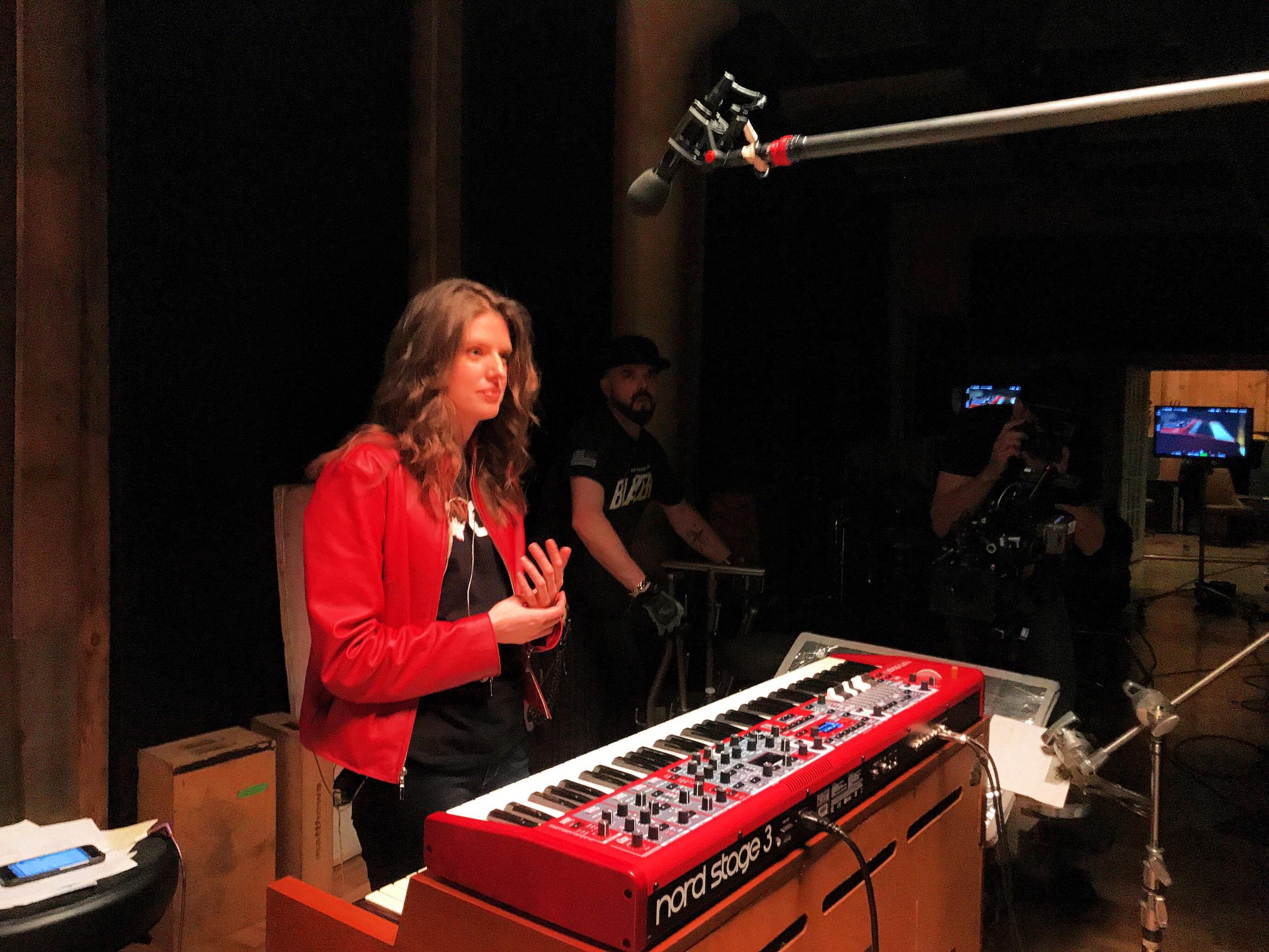 On-set between takes filming keyboard tutorials