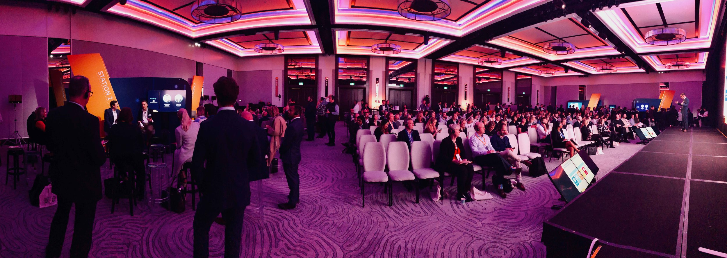 wide shot of multiple presentations using silent conference