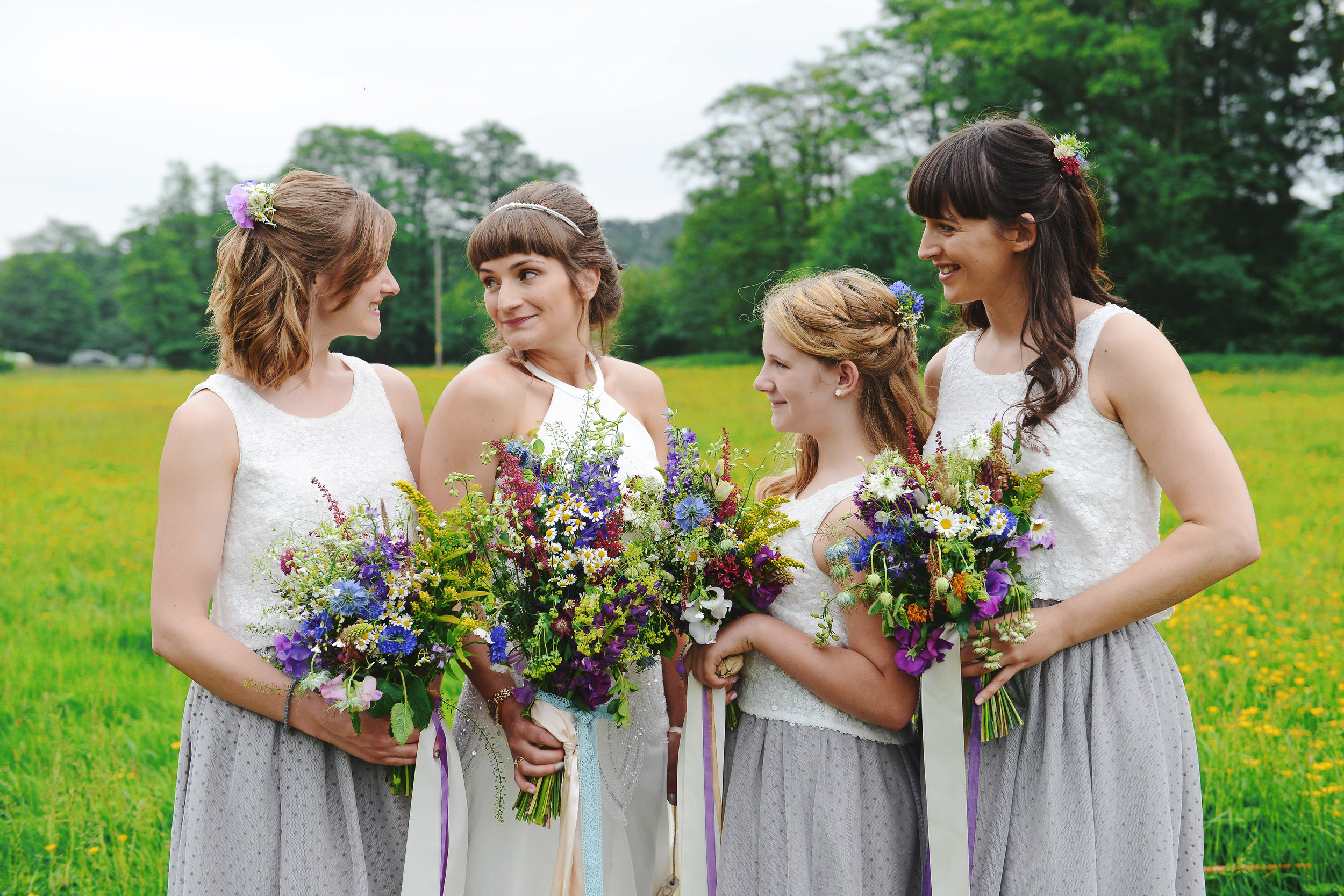 country garden wedding flowers with bride and maids.jpg
