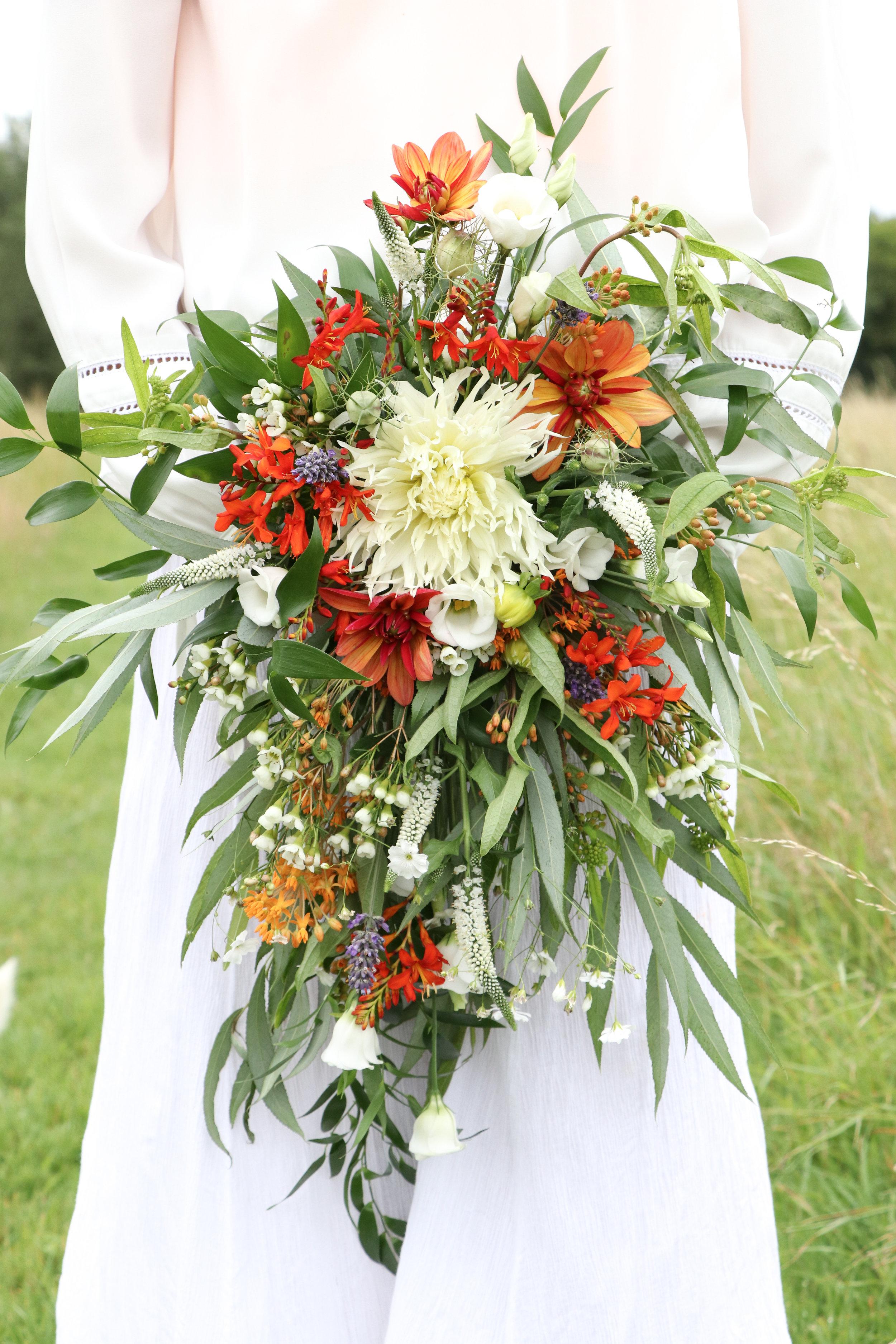 cascading organge white theme bridal bouquet.jpg