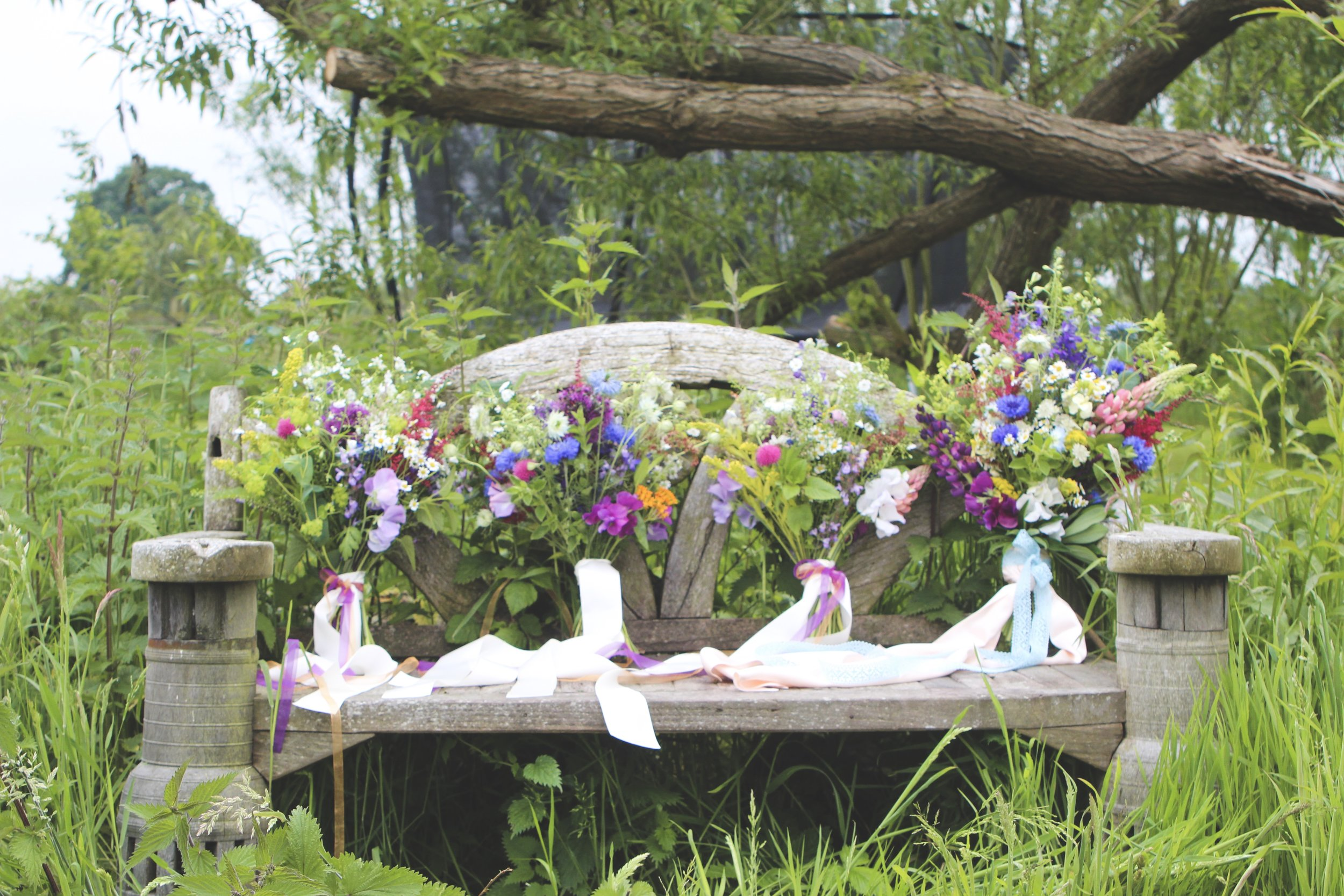 country garden bridal flowers on bench.jpg