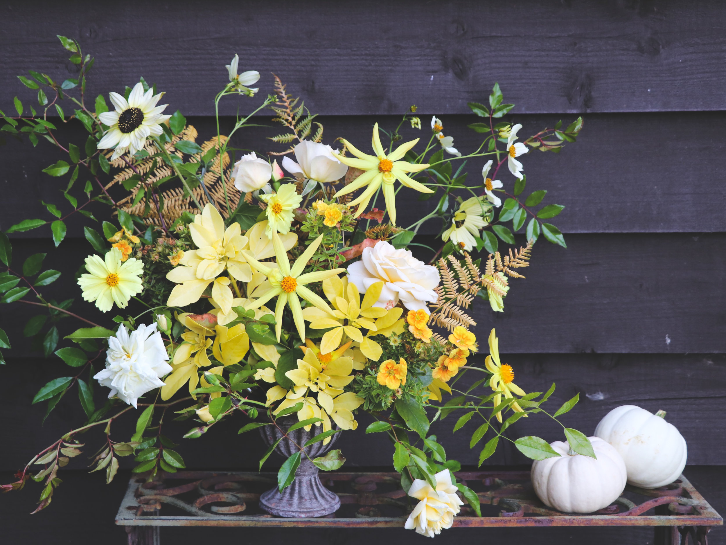 all the yellows flower arrangement in urn.jpg