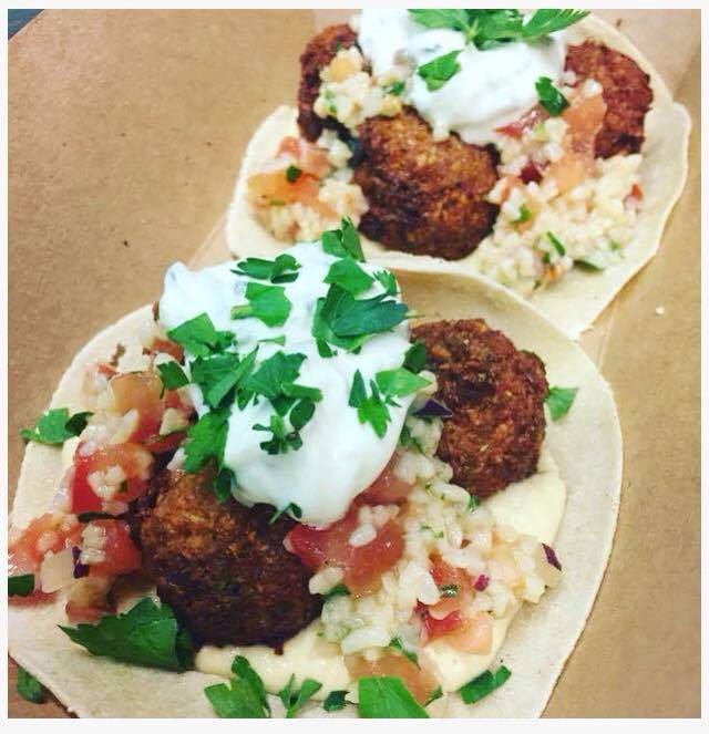 The Falawsome Taco - Middle Eastern falafel served with tabbouleh, hummus, tzatziki & fresh parsley