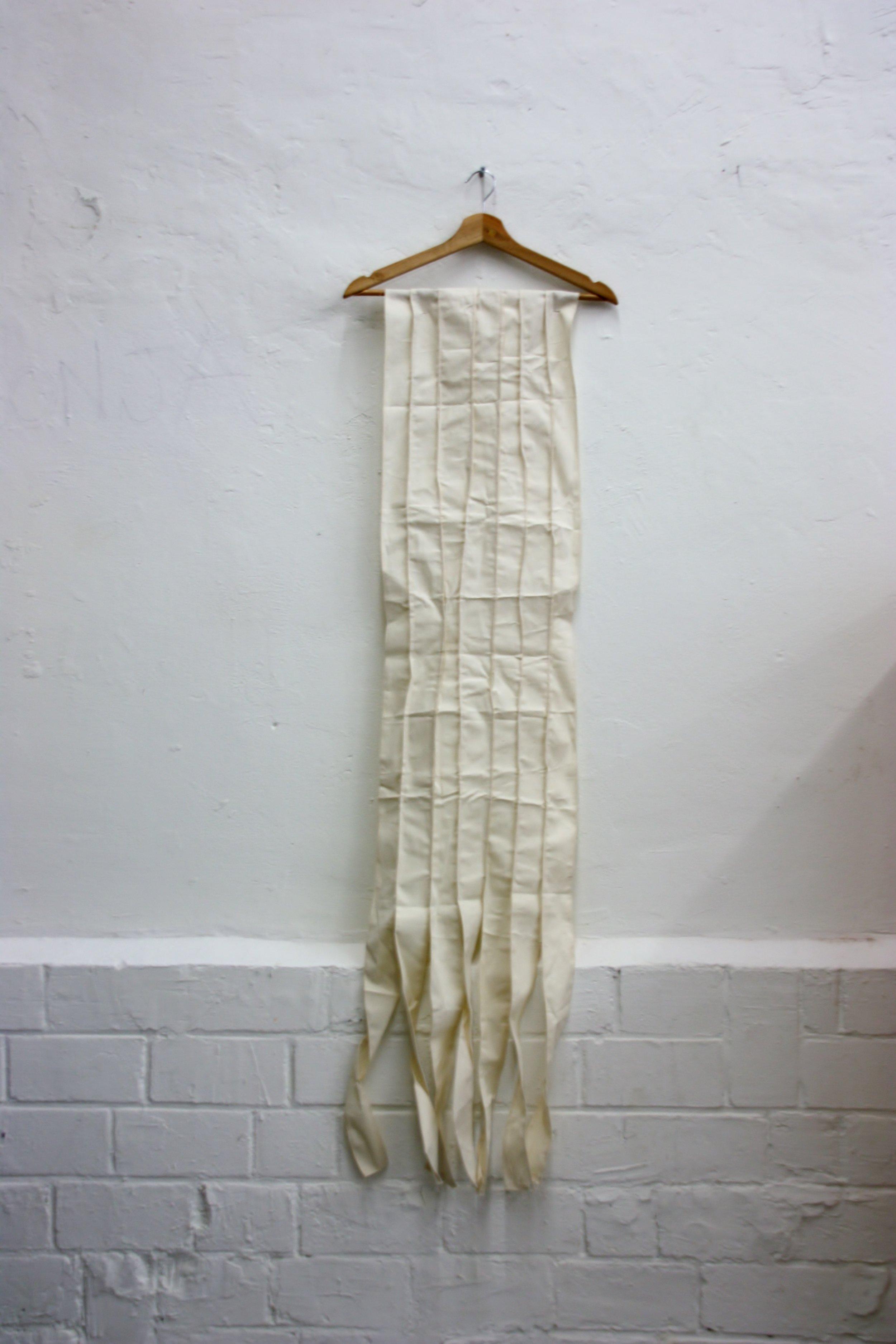 No Title , Textile and coat hanger, 2017