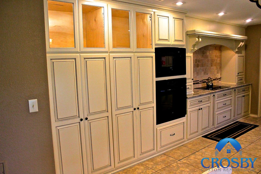 New Kitchen - We completely remodeled this kitchen in Spring, TX to incorporate new glazed cabinetry, custom woodworking, and perfect functionality for the homeowner.