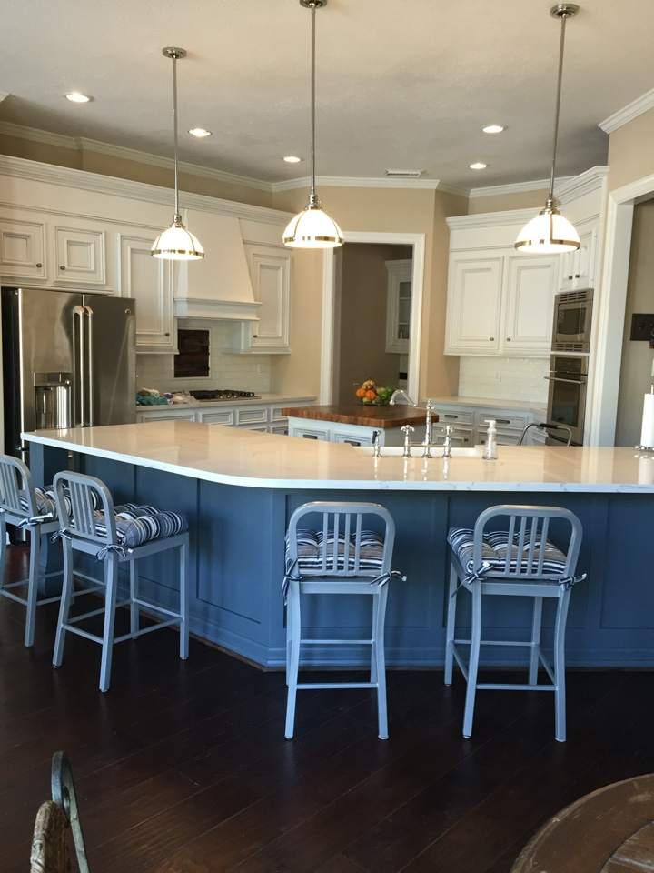 Making it Home - Our client in the North Hampton neighborhood in Spring, TX wanted to freshen up their newly purchased home by giving the kitchen a face lift.Some custom cabinetry, paint, lighting, Cambria Quartz countertops, and a reclaimed wood counter, we were able to give this remodeled kitchen a whole new feel!See below!