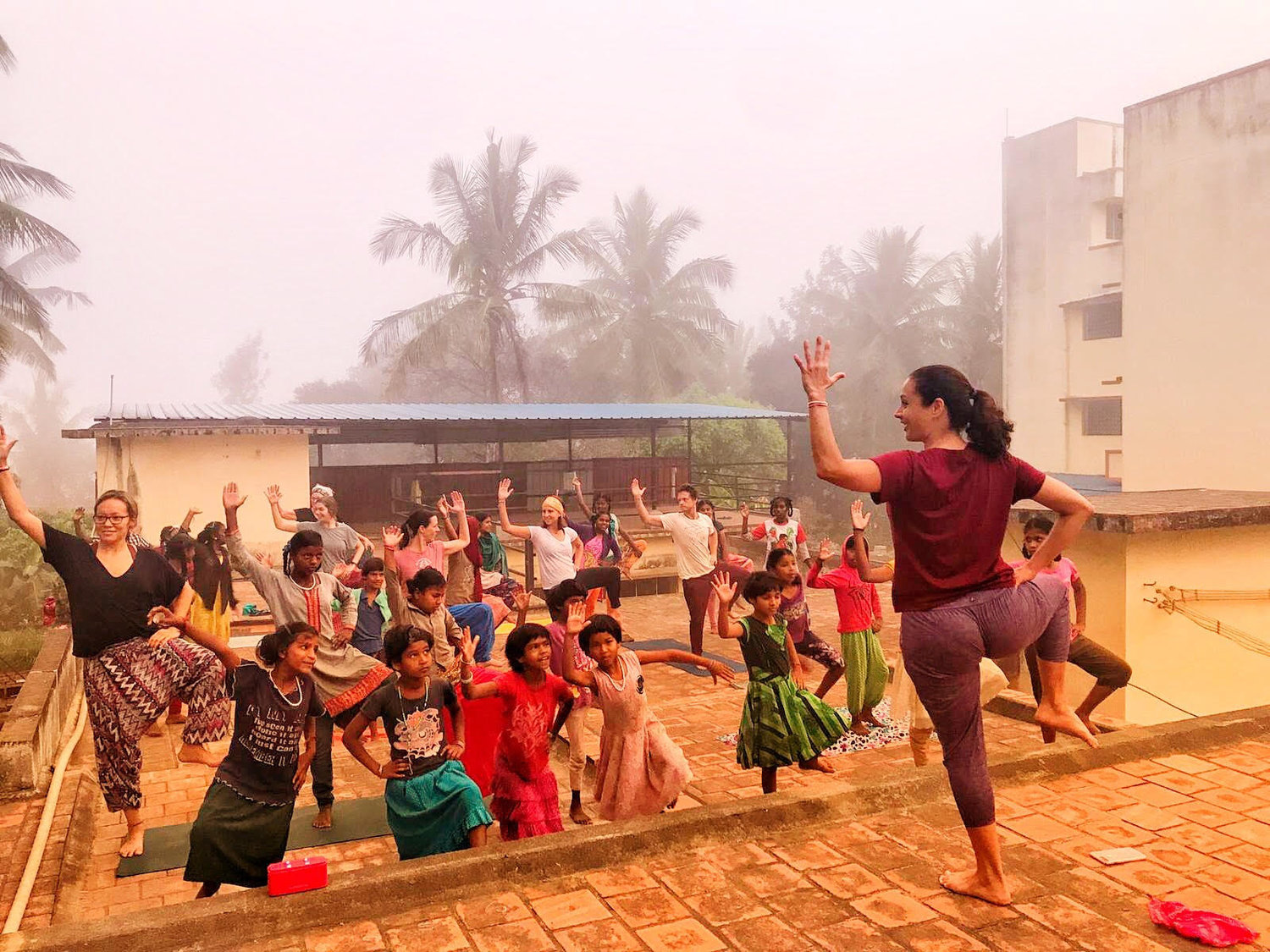 FlowTownYoga_teaching_yoga_to_orphans_retreat_india_mysore.jpg