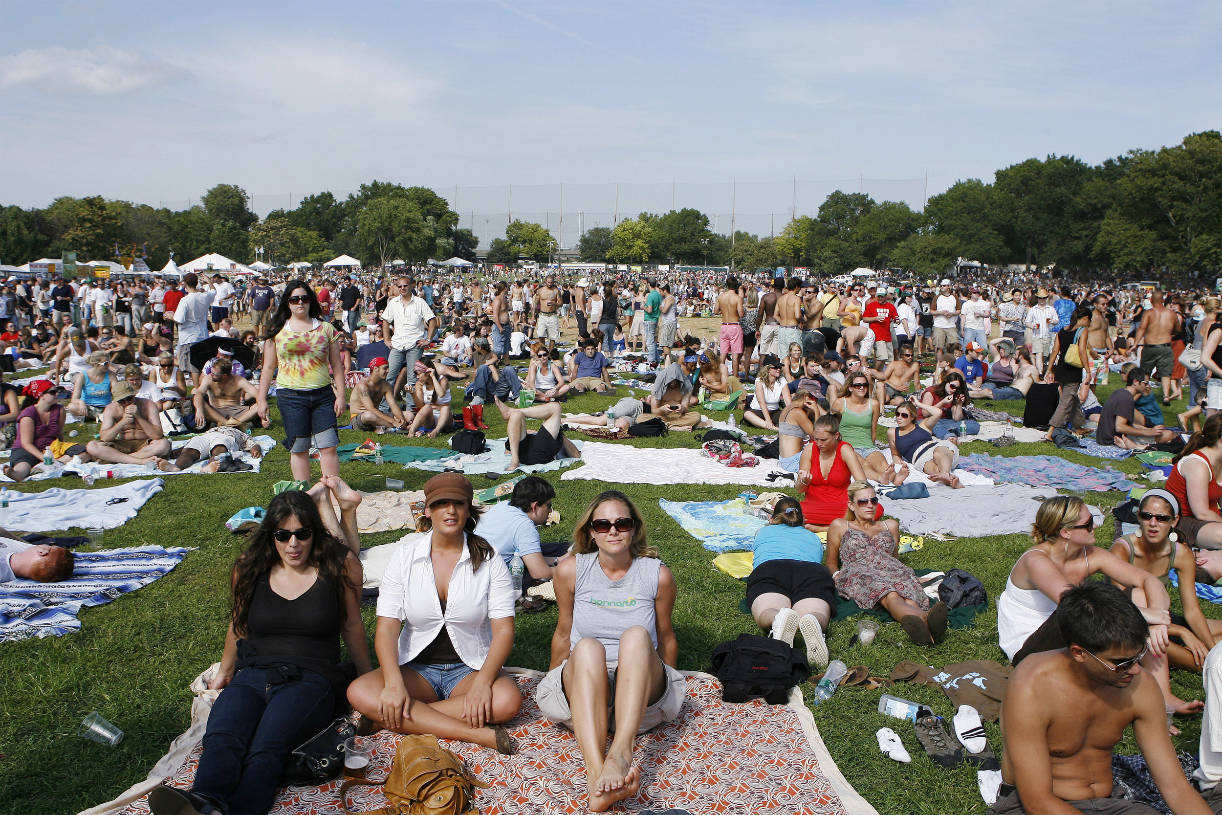 audience-members-sit-on-the-grass-on-randalls-island-during-the-2007-farm-aid-concert-in-new-york-september-9-2007.jpg