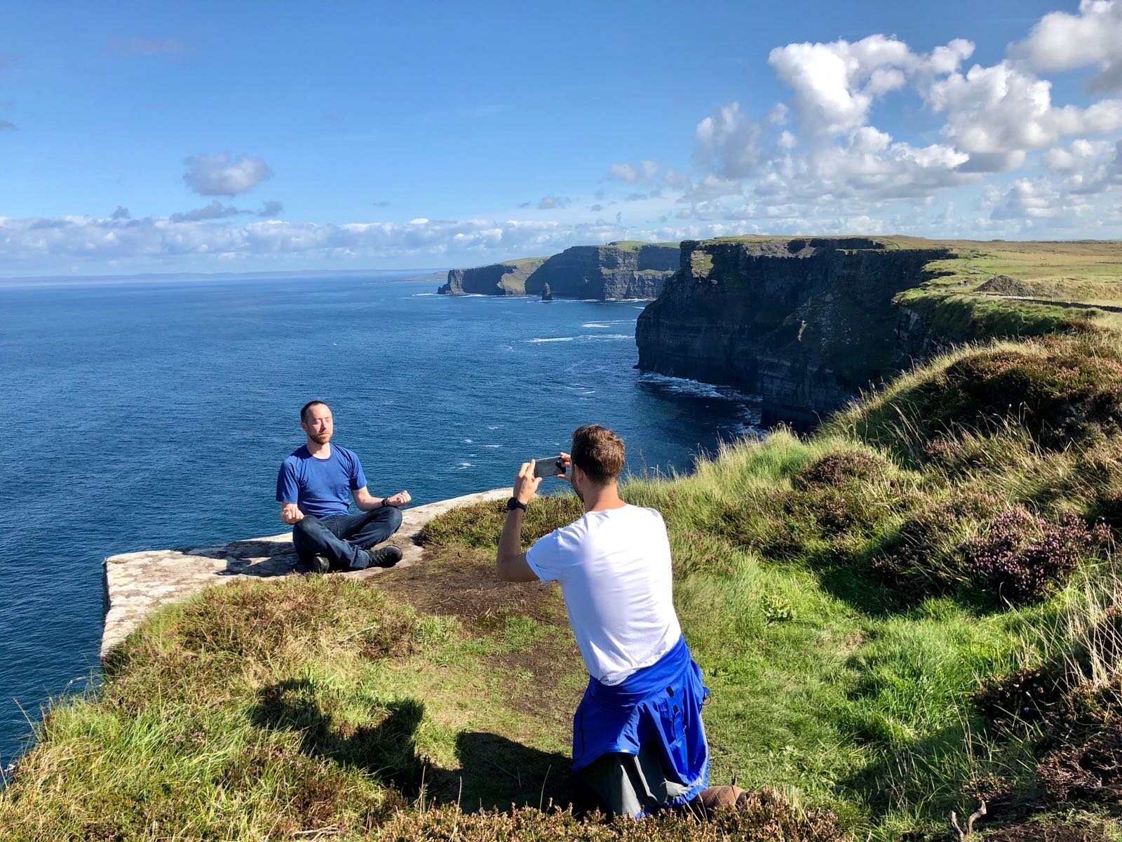 Ryan meditating on a cliff top at the famous Cliffs of Moher in Ireland. No big deal 😉