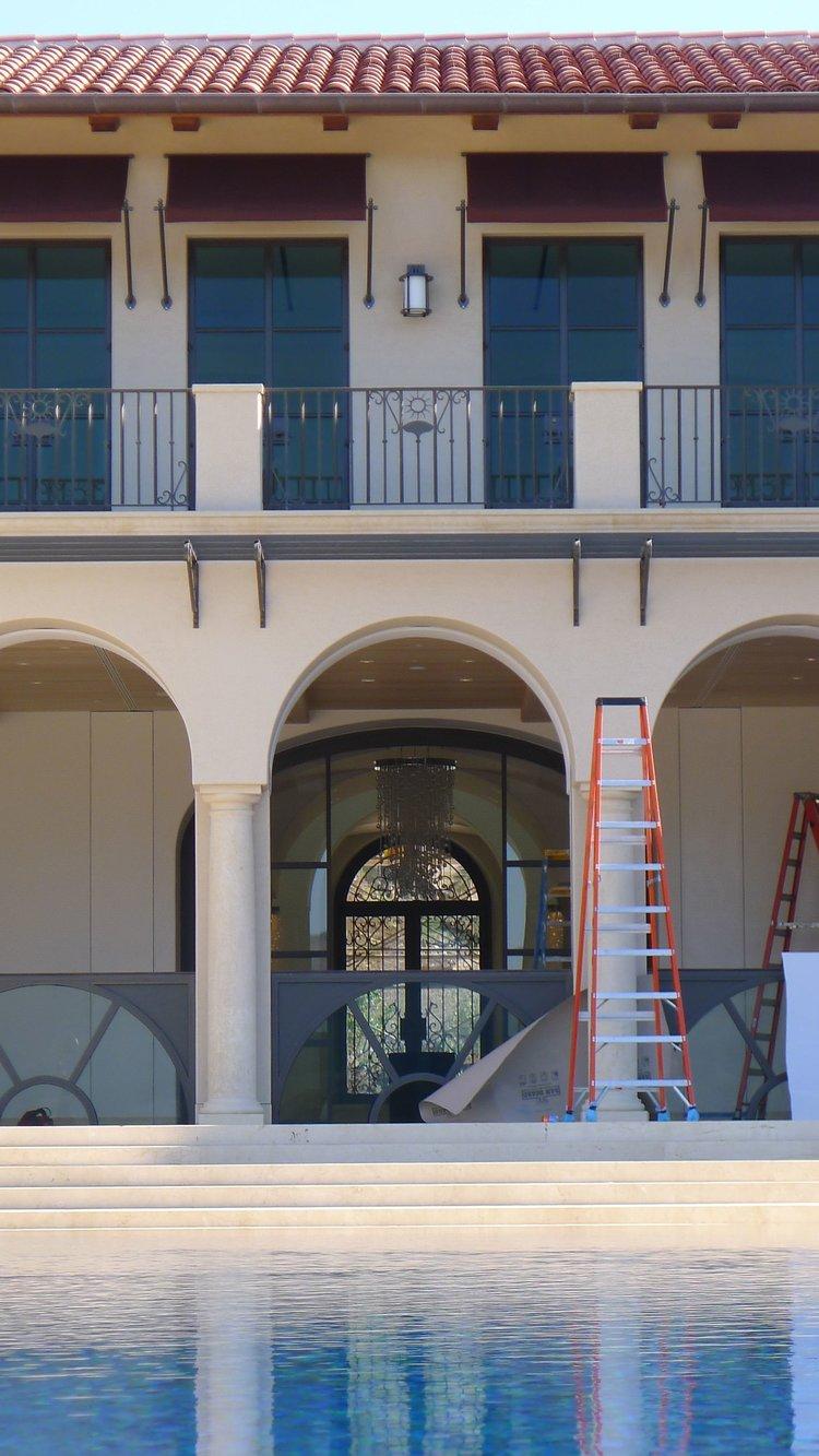 HYDRAULIC WINDOW WALL LOWERING INTO BASEMENT