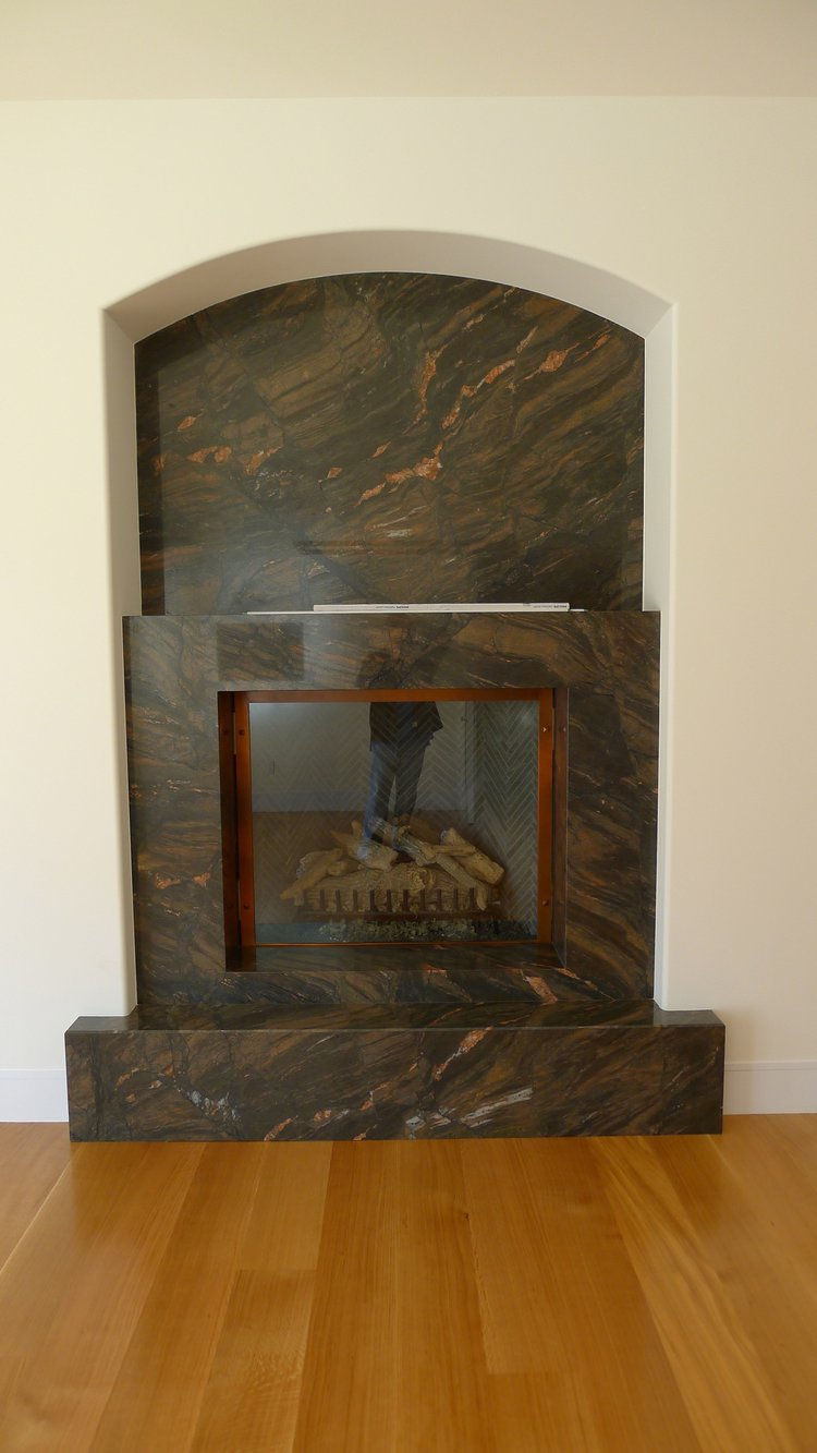 FIREPLACE SURROUND WITH STONE SELECTED BY OWNER