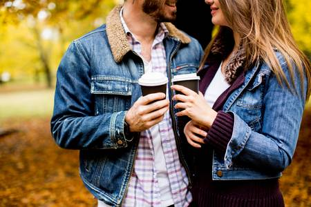 65332919-portrait-of-a-happy-romantic-couple-with-coffee-walking-outdoors-in-the-autumn-park.jpg