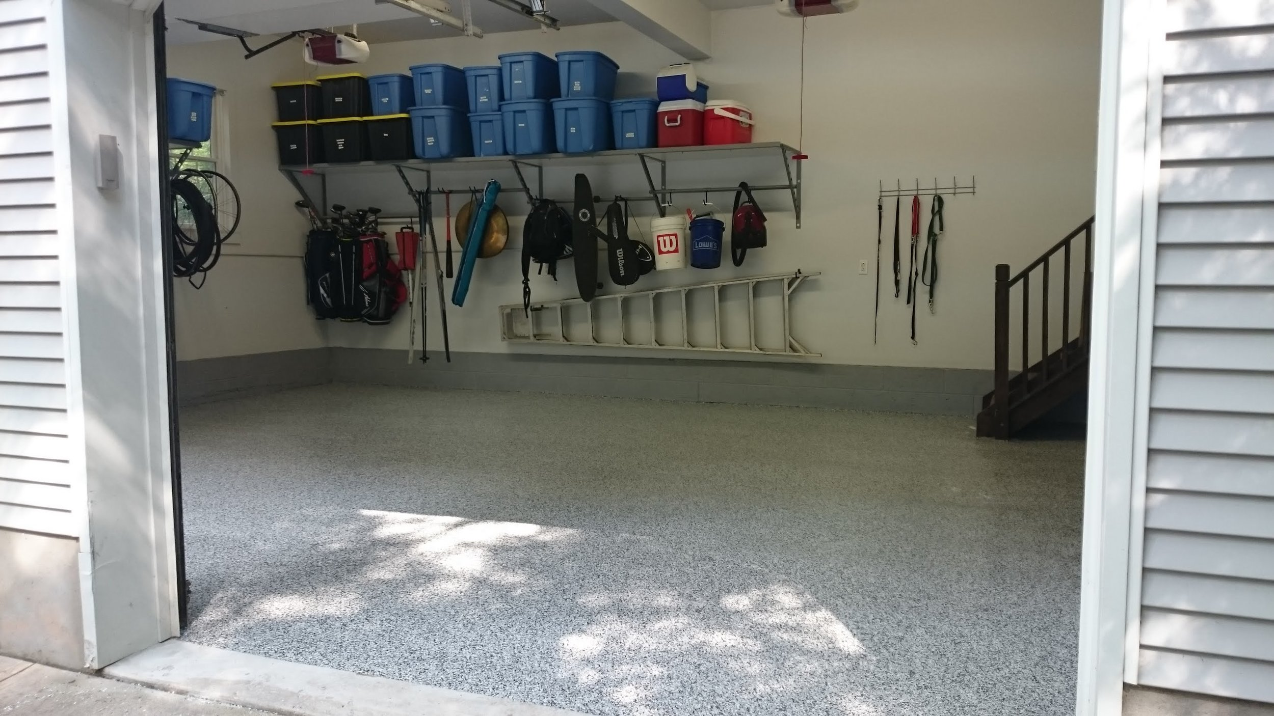 Garage concrete floor with polyurea / POLYASPARTIC coating with garage shelves with under-shelf adjustable rack storage example