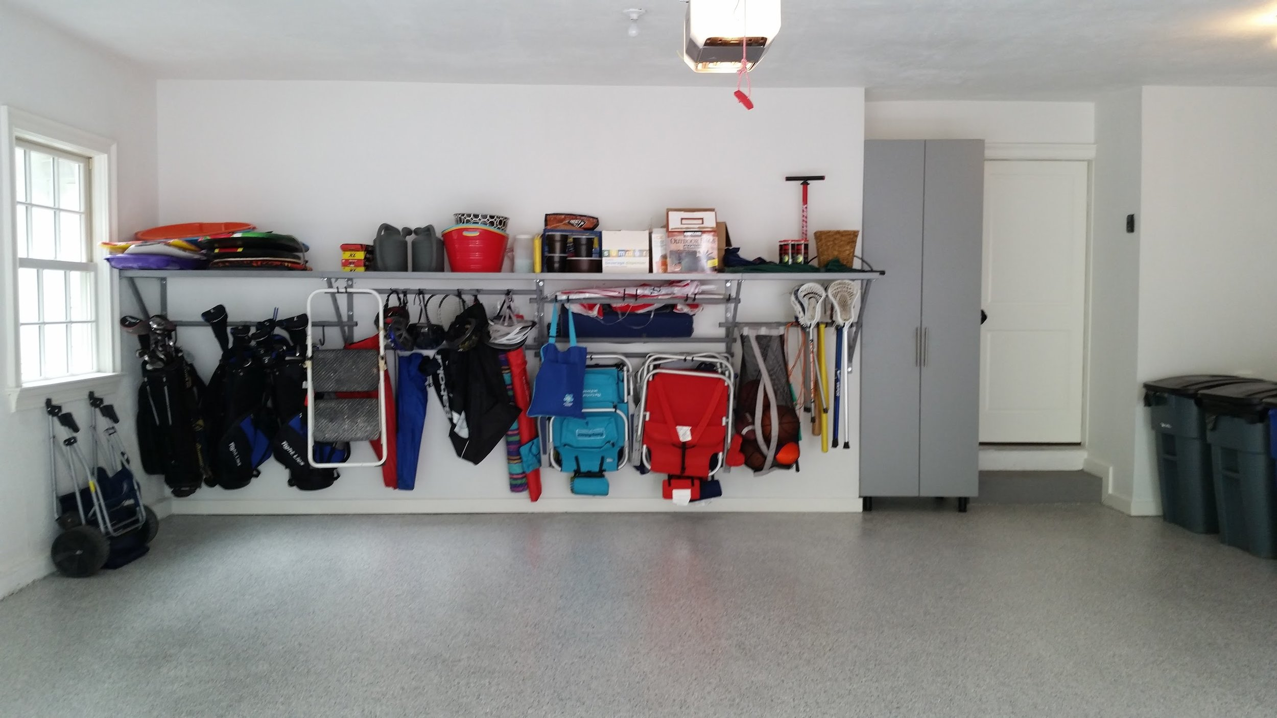 Garage concrete floor with polyurea / POLYASPARTIC coating with garage shelves and garage storage cabinets example