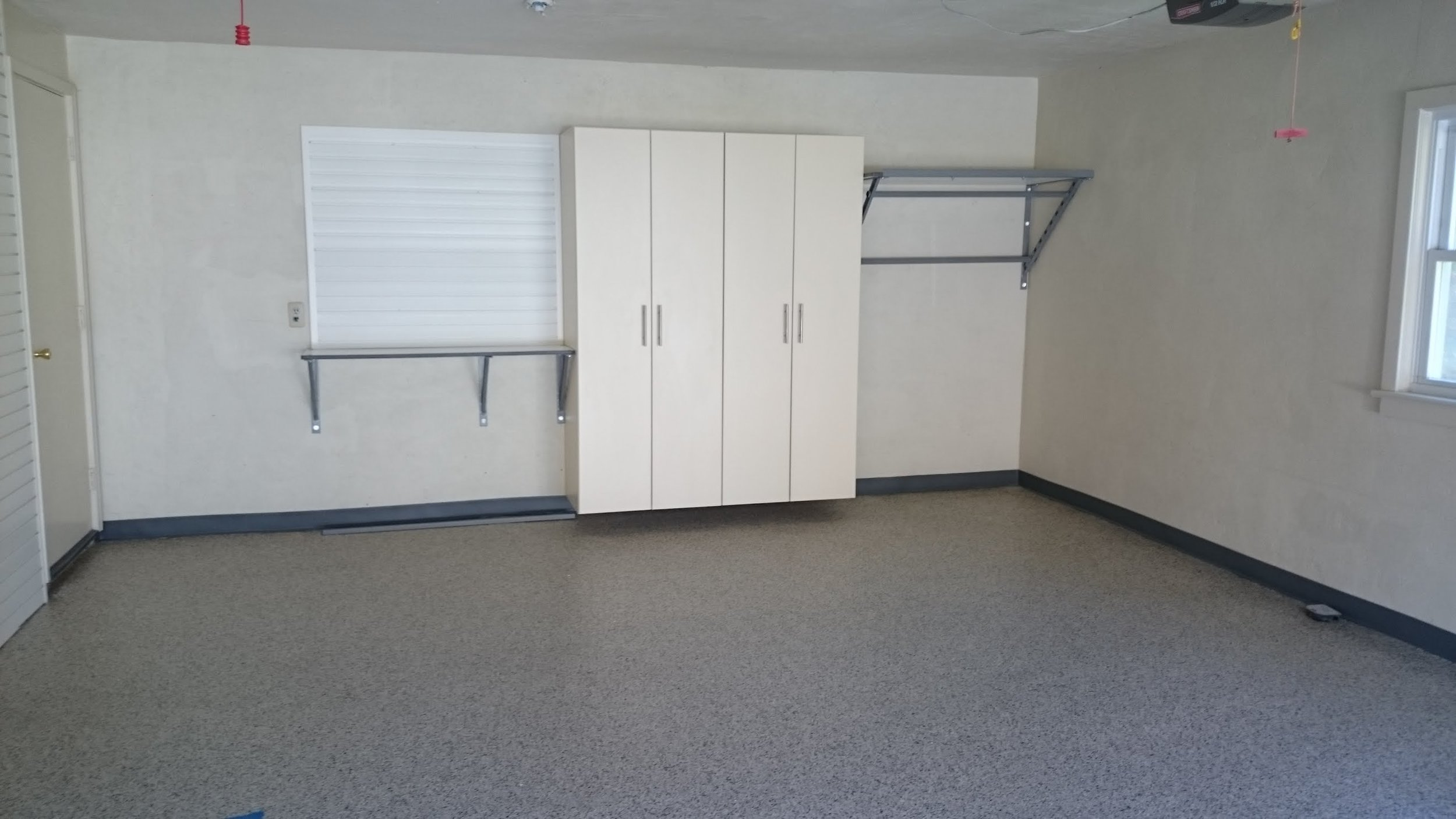Garage concrete floor with polyurea / POLYASPARTIC coating with garage storage cabinets and garage shelves example