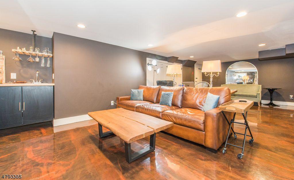 Decorative concrete floor coating for basement floor with wood texture example