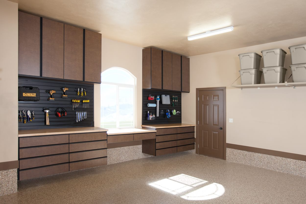 Garage storage system with cabinets, workbench, slat walls and drawers example