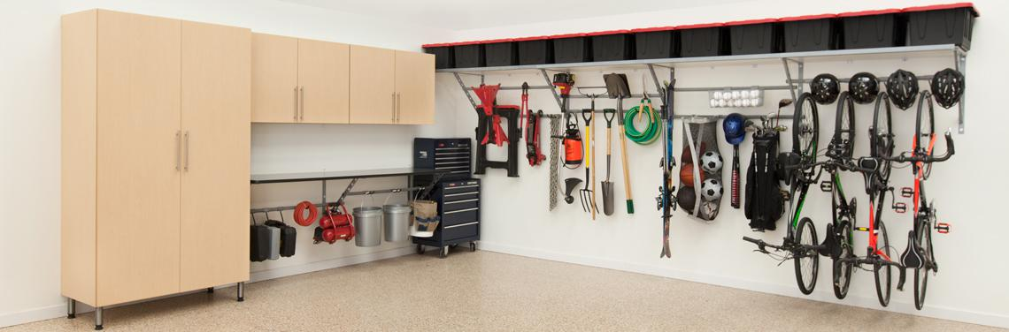 Complete garage storage system with cabinets, workbench, shelves with under-shelf adjustable rack storage for garden tools and sports equipment example