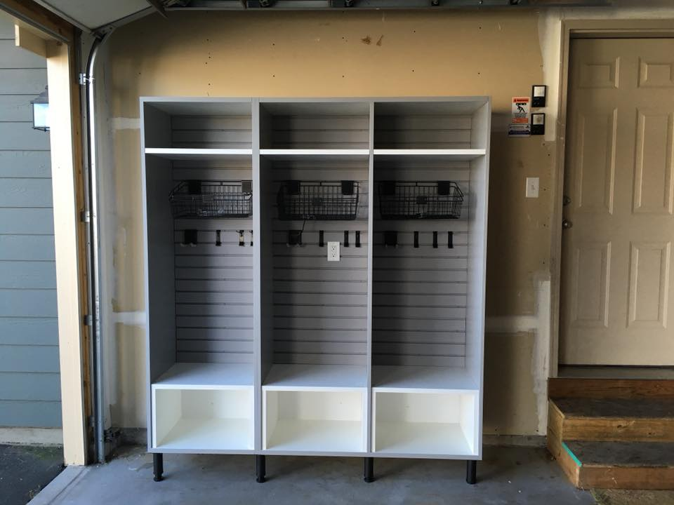 Garage mudroom cabinet with shoe bins, coat hooks and baskets for gloves and leashes example