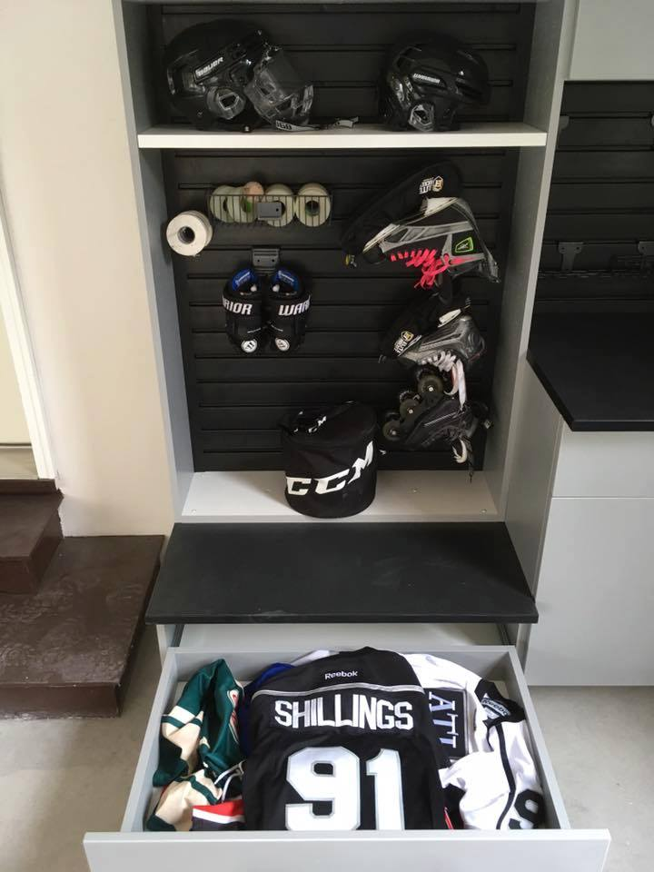 hockey gear in cabinet with drawer.jpg