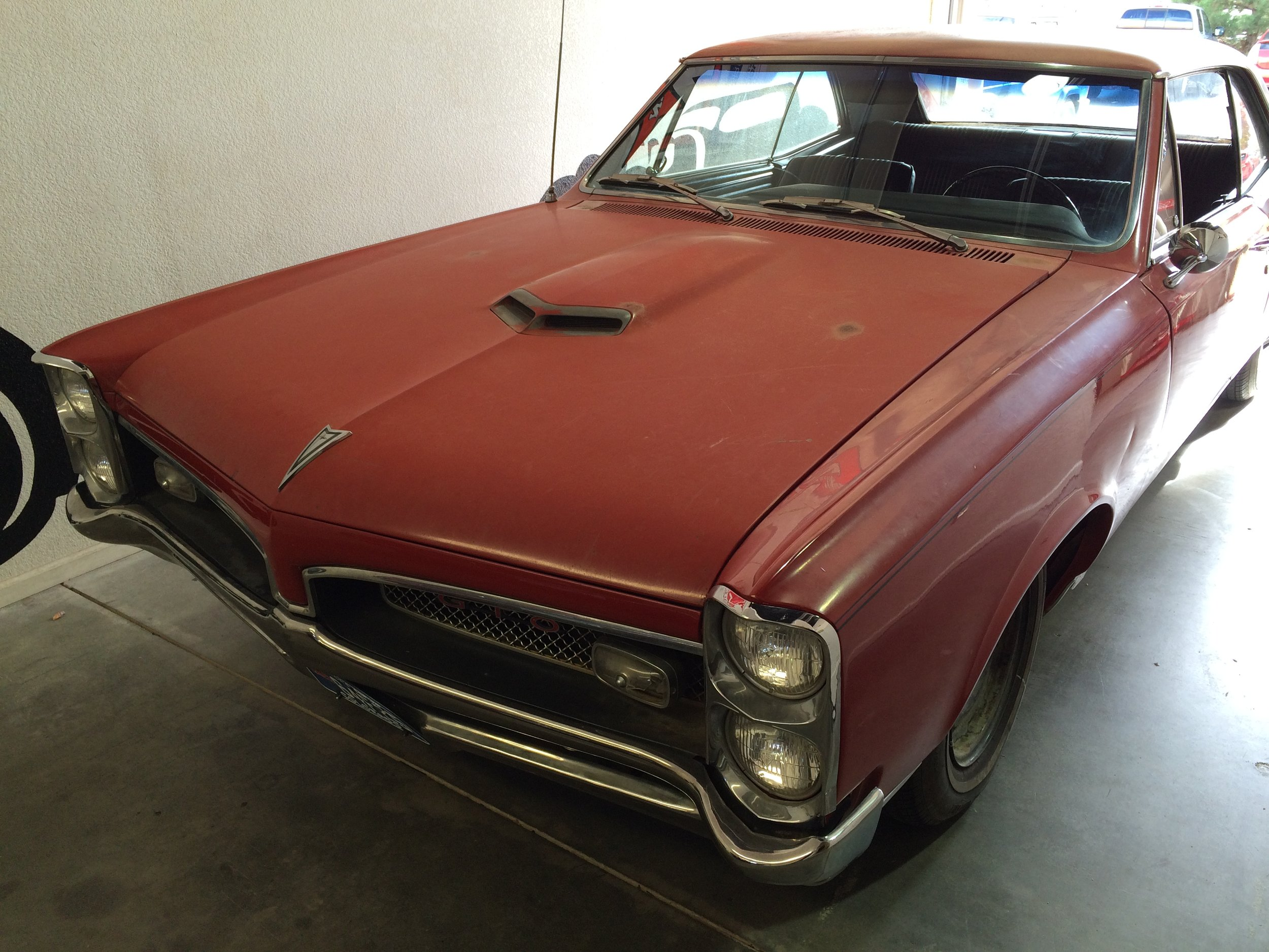 The GTO came into the shop as a totally stock, single owner car - In this photo you can see the car was all there, just needed to be brought back to life. The paint had faded because of the sun. Interior cracked and faded. Suspension was soft and old.