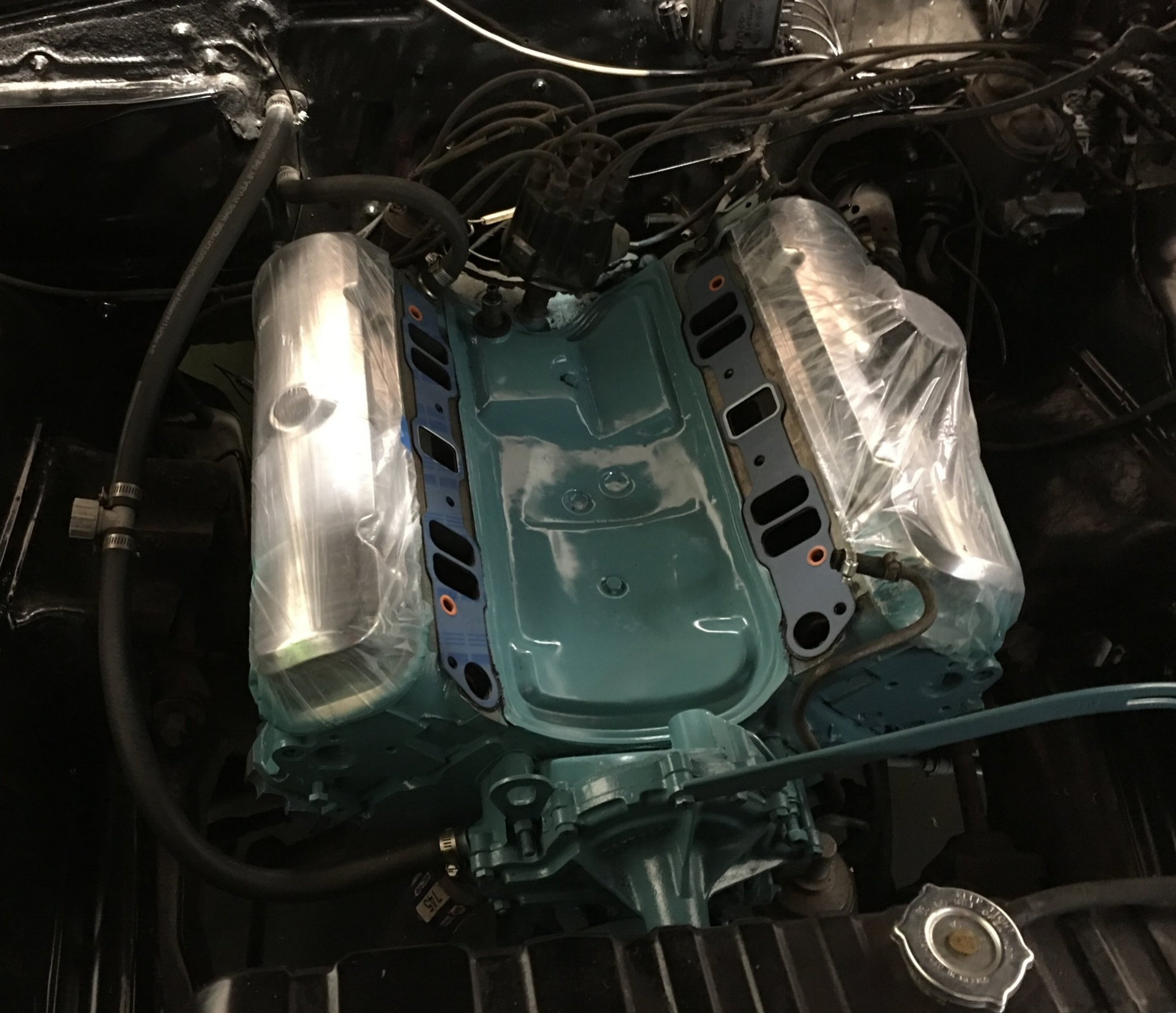 The factory 400 was given a minor restore - Everything really ran great on the car, we just freshened the paint, changed a few seals, rebuilt the factory carb. and installed a more modern and reliable ignition. Replacing the points ignition really makes the car fun to drive.