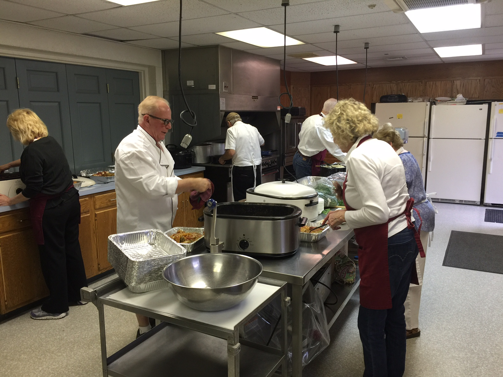Chef Steve Bandura and his crew of volunteers  preparing food for the LCI Family Banquet fundraiser.
