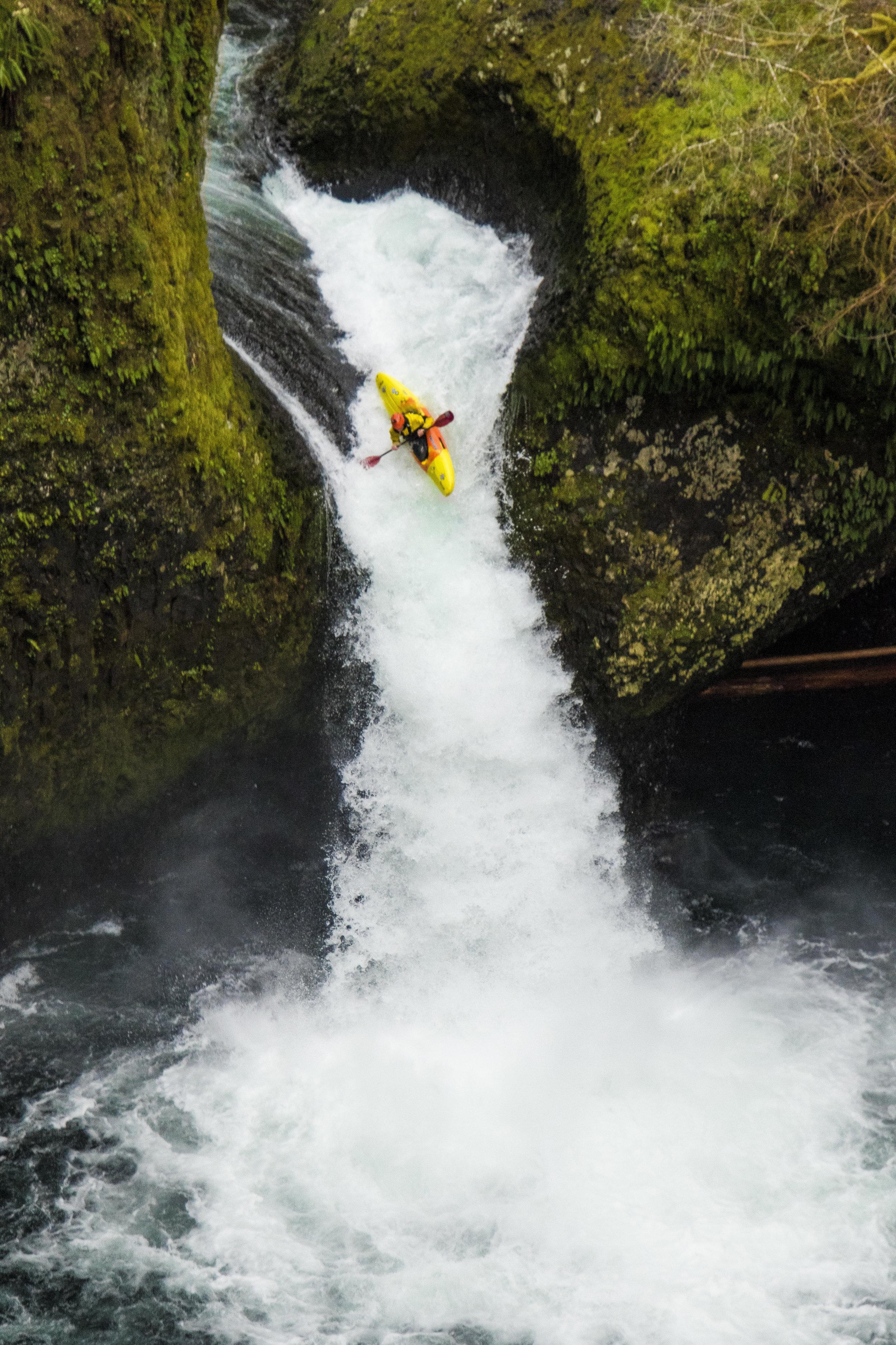 Kayaker hitting a Waterfall
