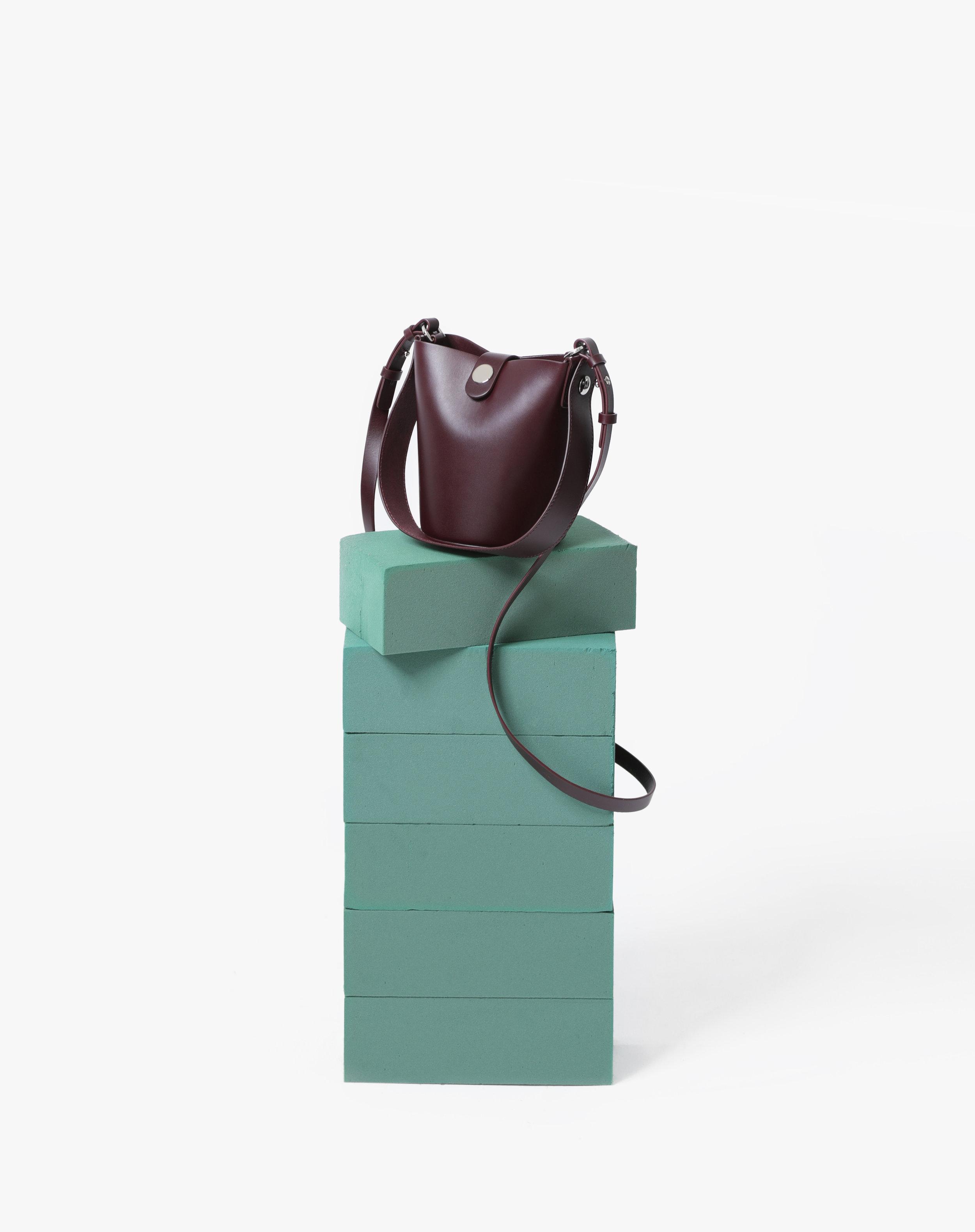 handbag on plinth