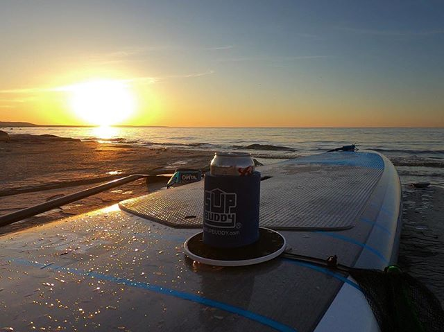 """@shreddymcdolan calls this one """"Balance + Beer"""" 🌅 thanks for the awesome pic! . Never paddle alone, always bring your #SUPBuddy 🤙🏼 . . . #supbuddy #standuppaddle #sunset #sunsetsup #supcanada #summer #isup #h20 #riverdays #summertime #easylivin #cheers"""